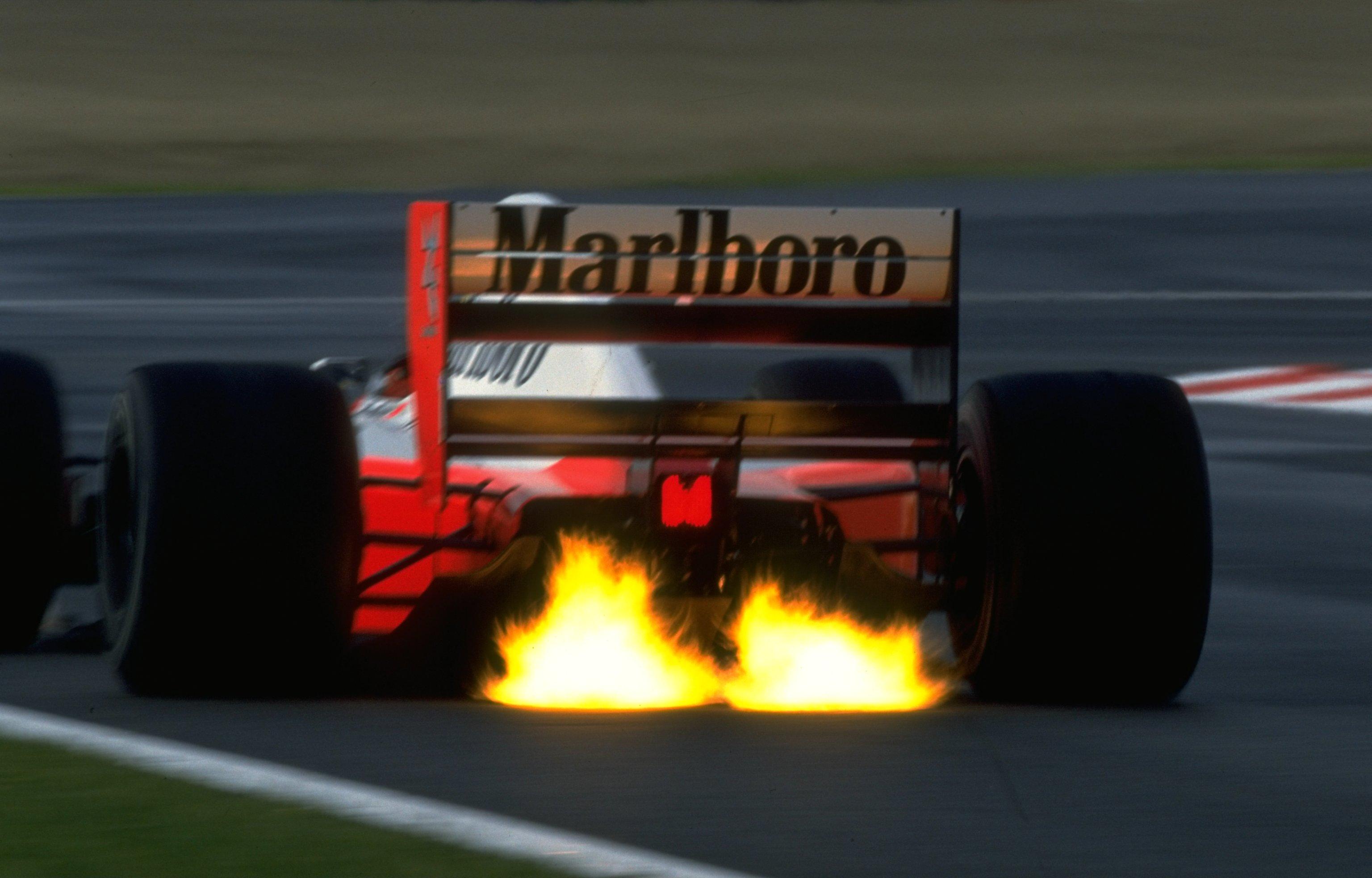 General 3072x1968 Ayrton Senna McLaren Formula 1 vehicle race cars racing sports sport  fire formula cars backfire exaust flare motorsports