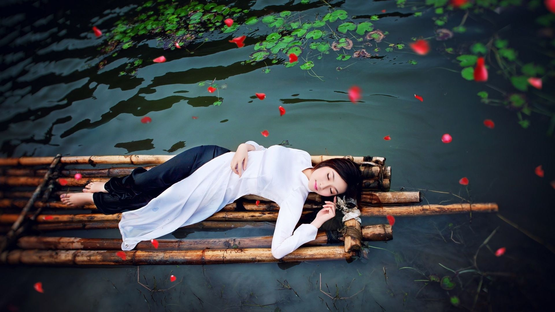 People 1920x1080 women model brunette long hair Asian closed eyes women outdoors lying on back nature water flower petals barefoot raft bamboo relaxation relaxing high angle