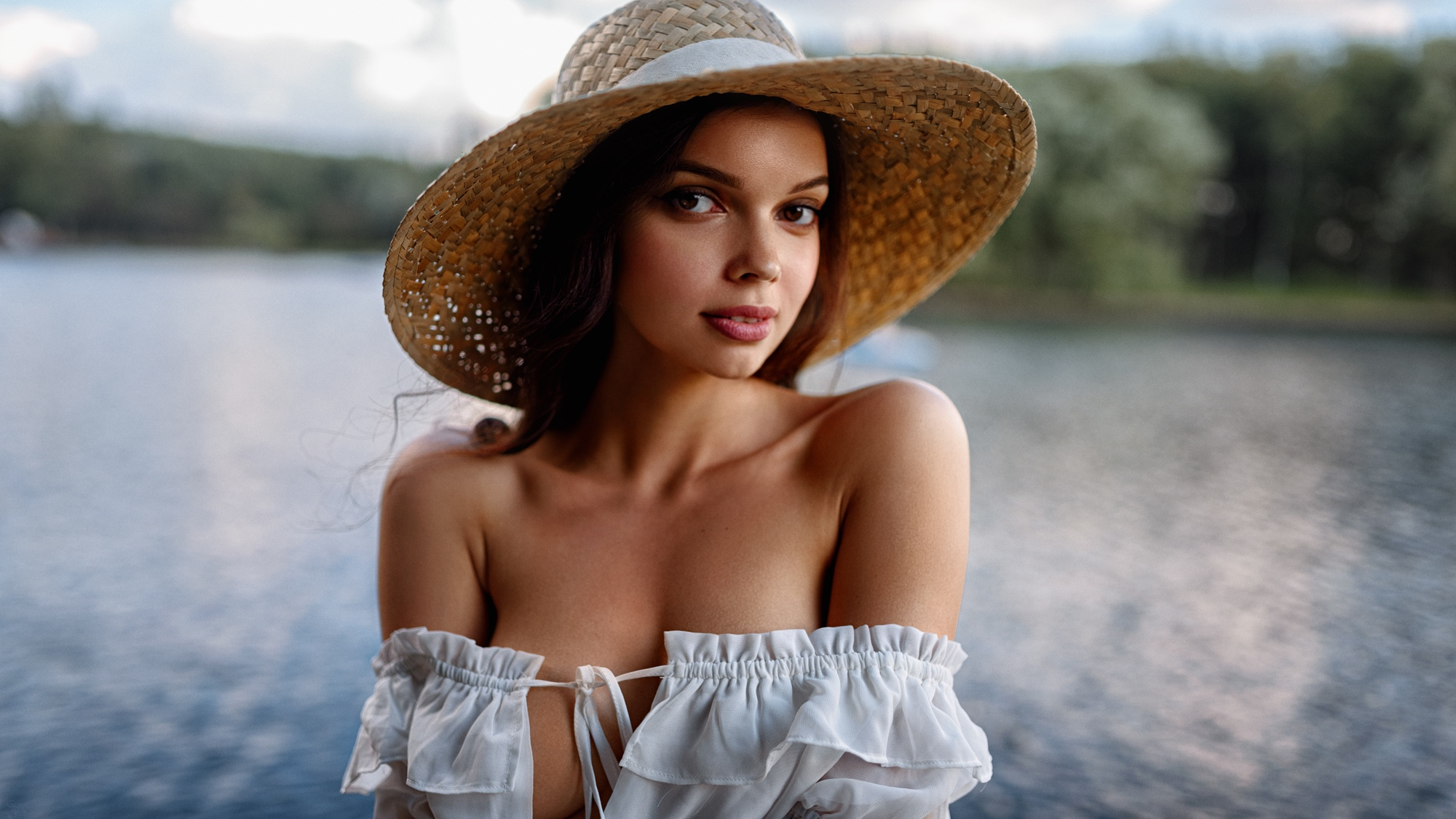 People 2000x1125 Angelika Svoykina women model brunette long hair brown eyes portrait looking at viewer bare shoulders cleavage no bra women with hats straw hat white tops lake depth of field smiling Georgy Chernyadyev outdoors