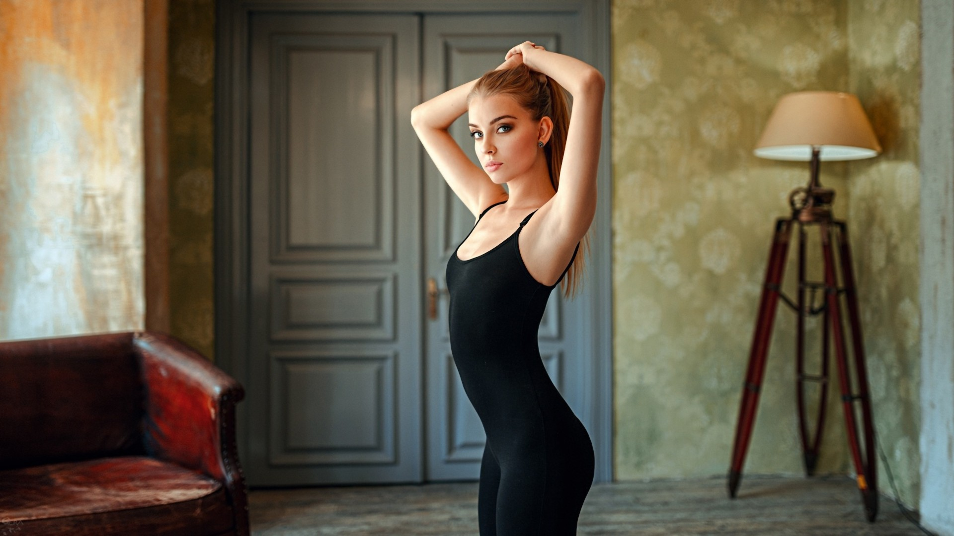 People 1920x1080 women blonde hands on head armpits ass portrait looking at viewer Georgy Chernyadyev Victoria Pichkurova leotard lamp couch door small boobs onesie women indoors indoors arms up