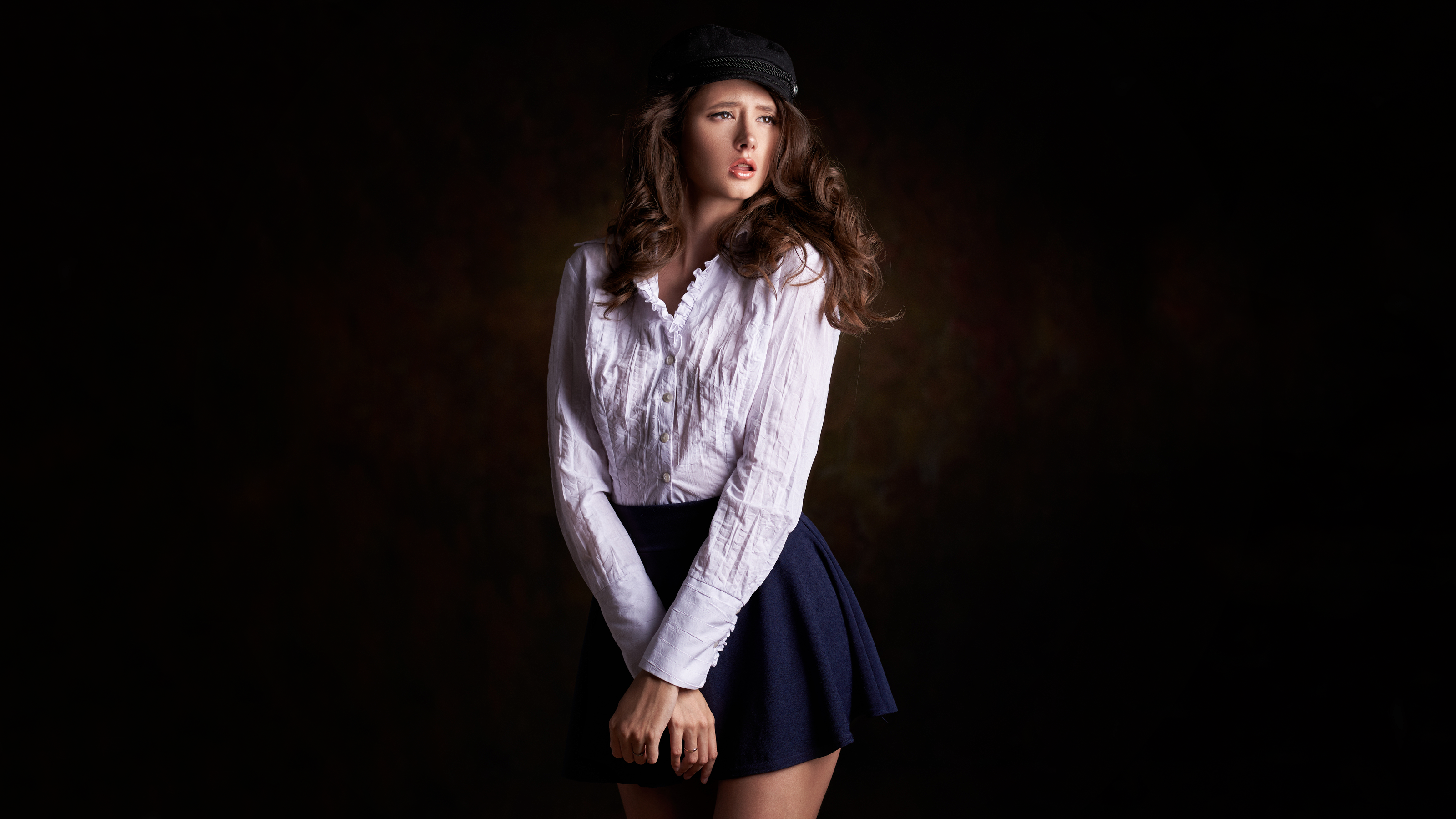 People 3200x1800 Disha Shemetova women model brunette long hair wavy hair berets brown eyes looking away pink lipstick open mouth shirt miniskirt simple background dark background brown background dark black brown vignette portrait photography standing white shirt Max Pyzhik