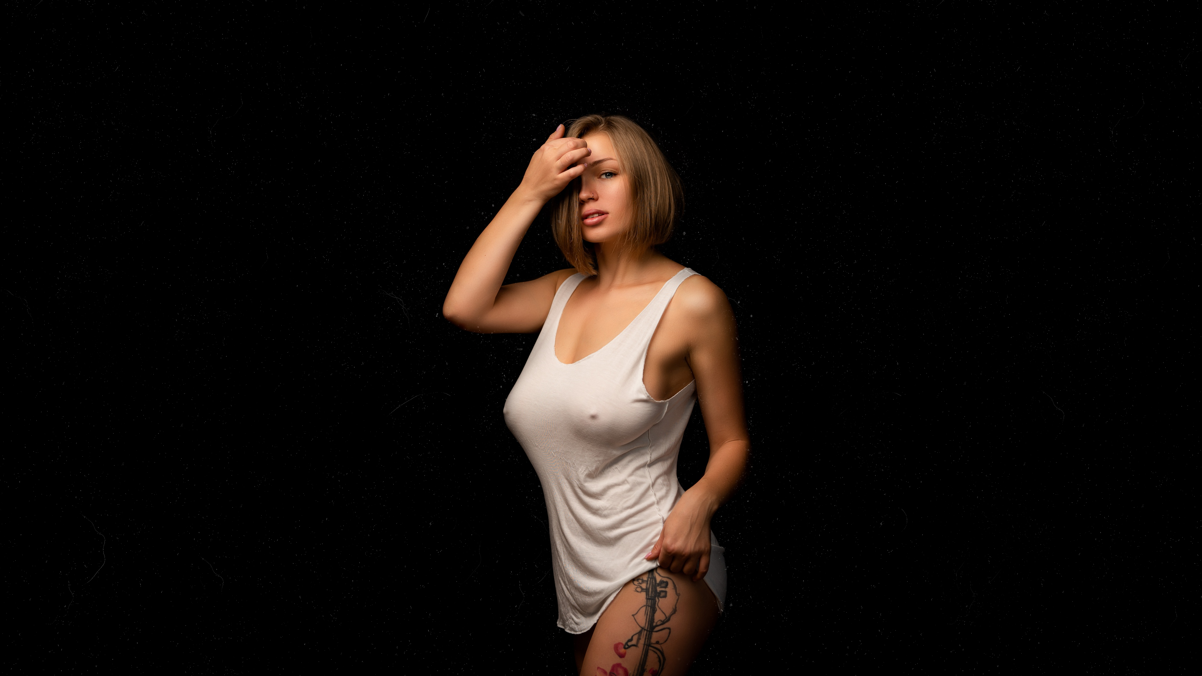 People 3840x2160 Anna Bykanova women model blonde looking at viewer gray eyes hair in face tank top cleavage no bra nipples through clothing nose rings tattoo inked girls portrait black background dust Ilya Pistoletov nipple bulge white tops