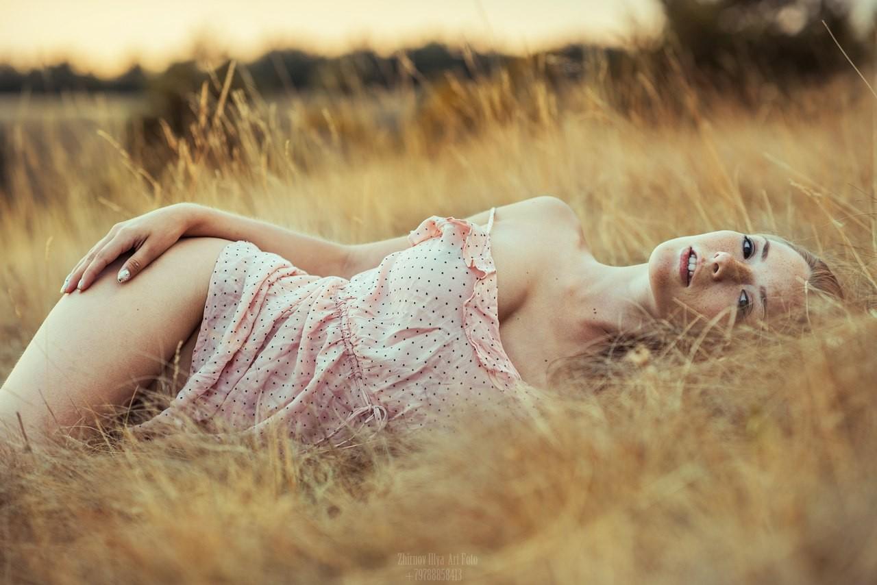 People 1280x854 women Olga Kobzar model lying on side looking at viewer field women outdoors freckles Ilya Zhirnov bottomless