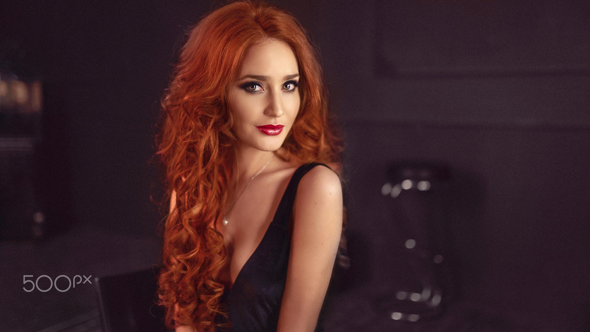 People 2048x1153 women redhead face dress bokeh long hair wavy hair eyeshadow red lipstick no bra portrait cleavage smirk hazel eyes black clothing