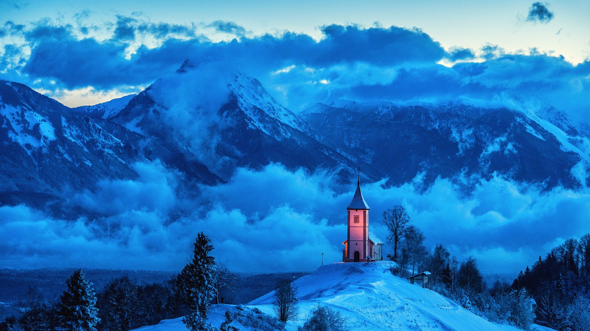 General 1920x1079 landscape mountains snow church mist winter clouds hills Slovenia snowy peak cyan blue