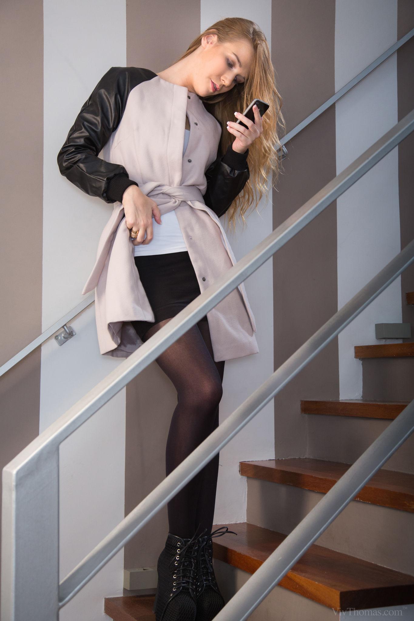 People 1365x2048 women Alexis Crystal coats black skirts flashing stairs reading long hair white tops standing VivThomas pornstar women indoors black boots stockings