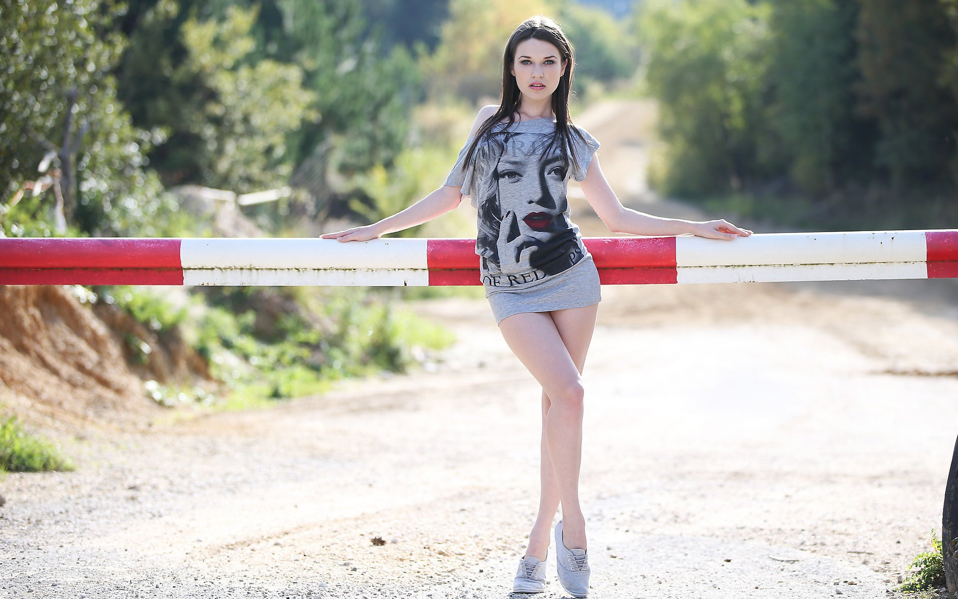 People 1920x1200 women brunette road blocks Serena Wood long hair looking at viewer standing minidress tiptoe standing on one leg outdoors bare shoulders T-shirt frontal view pointed toes women outdoors model