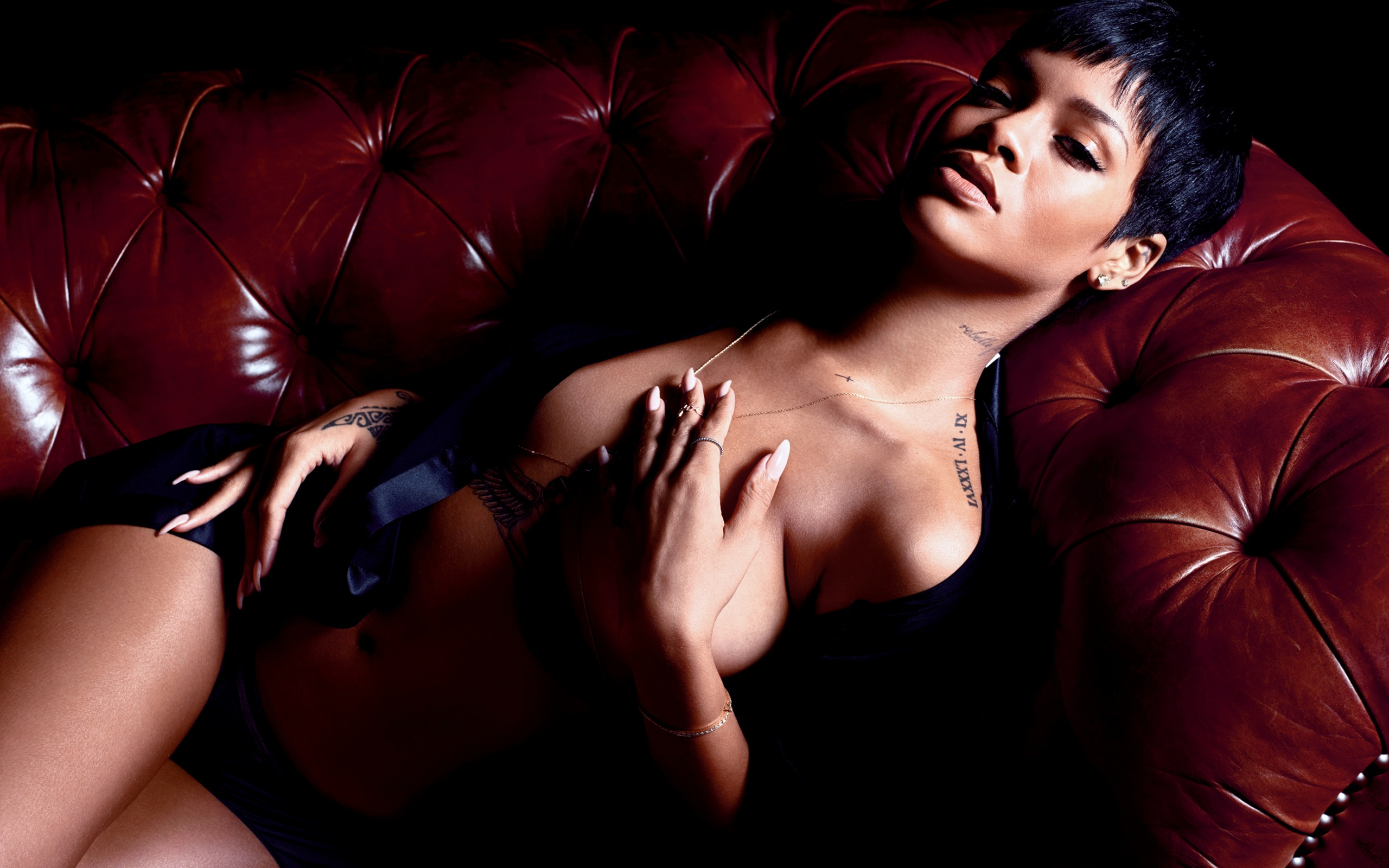 People 2560x1600 Rihanna singer tattoo couch strategic covering nude women celebrity women indoors short hair dark hair indoors inked girls