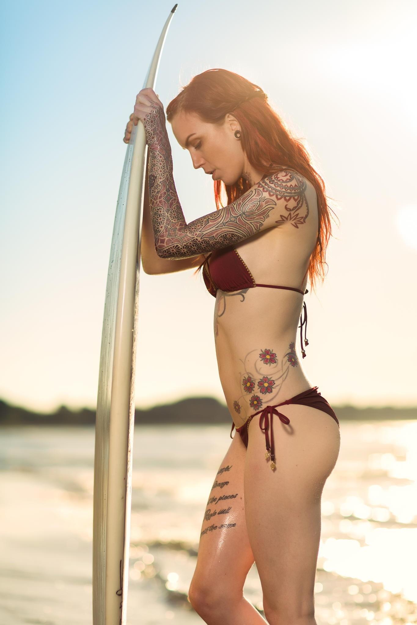 People 1365x2048 women model redhead long hair Linnea Thomasia tattoo portrait display closed eyes women outdoors swimwear bikini surfing sea hills waves sunlight open mouth piercing wet body surfboards
