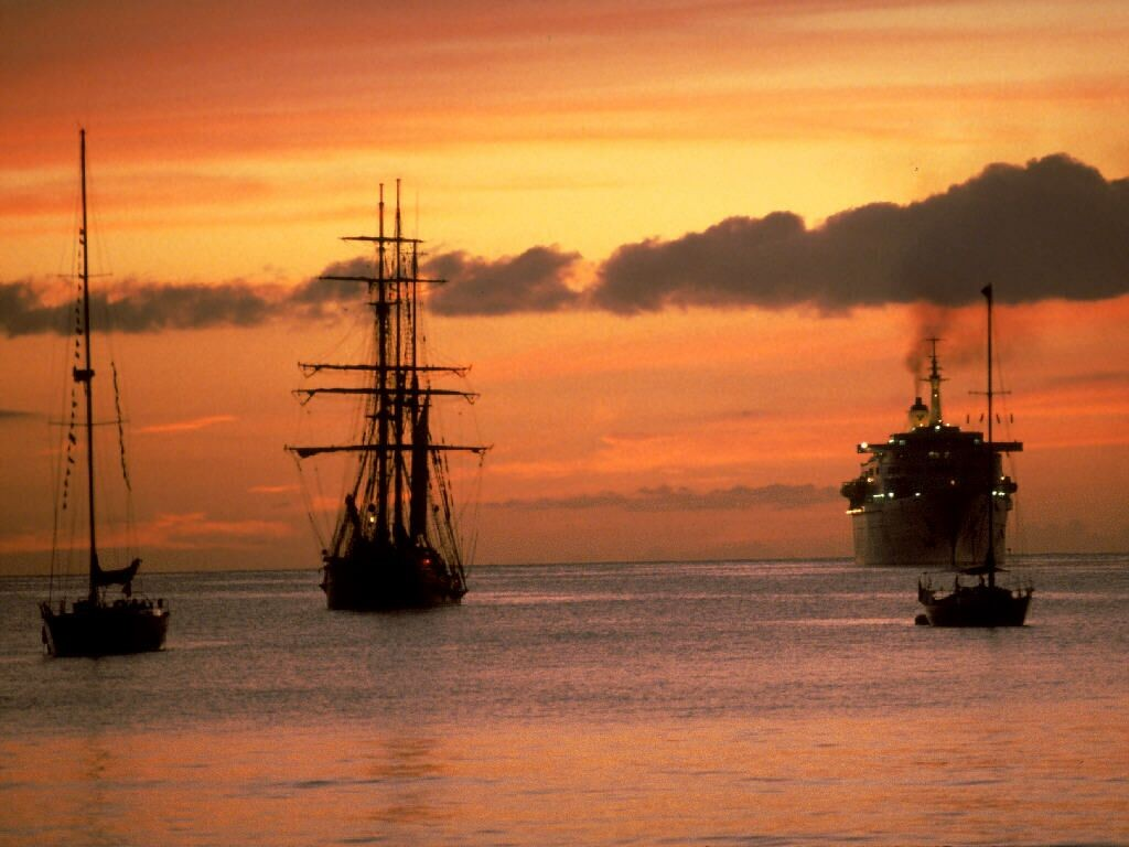 General 1024x768 sunset ship sea clouds red sky