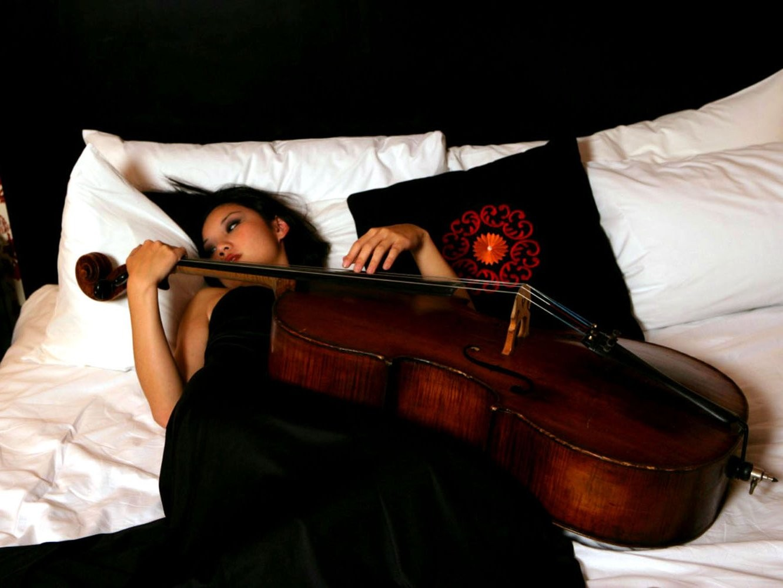 People 1332x1000 cello women in bed musical instrument Asian lying on back looking away dark hair makeup women indoors indoors