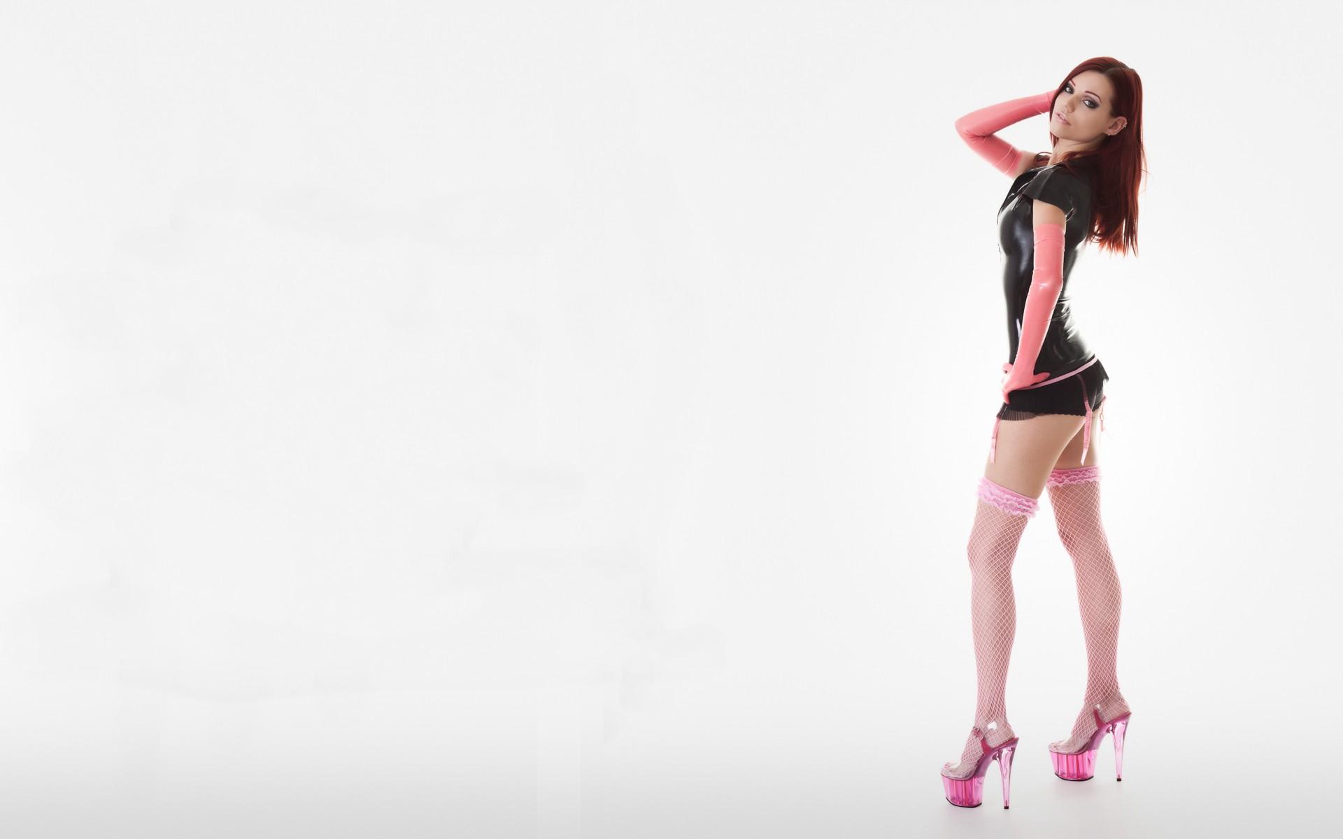 People 1920x1200 latex high heels redhead fishnet stockings stockings pink fishnet pink stockings pink lipstick pink heels looking at viewer simple background white background garter belt looking over shoulder gloves elbow gloves pierced ears