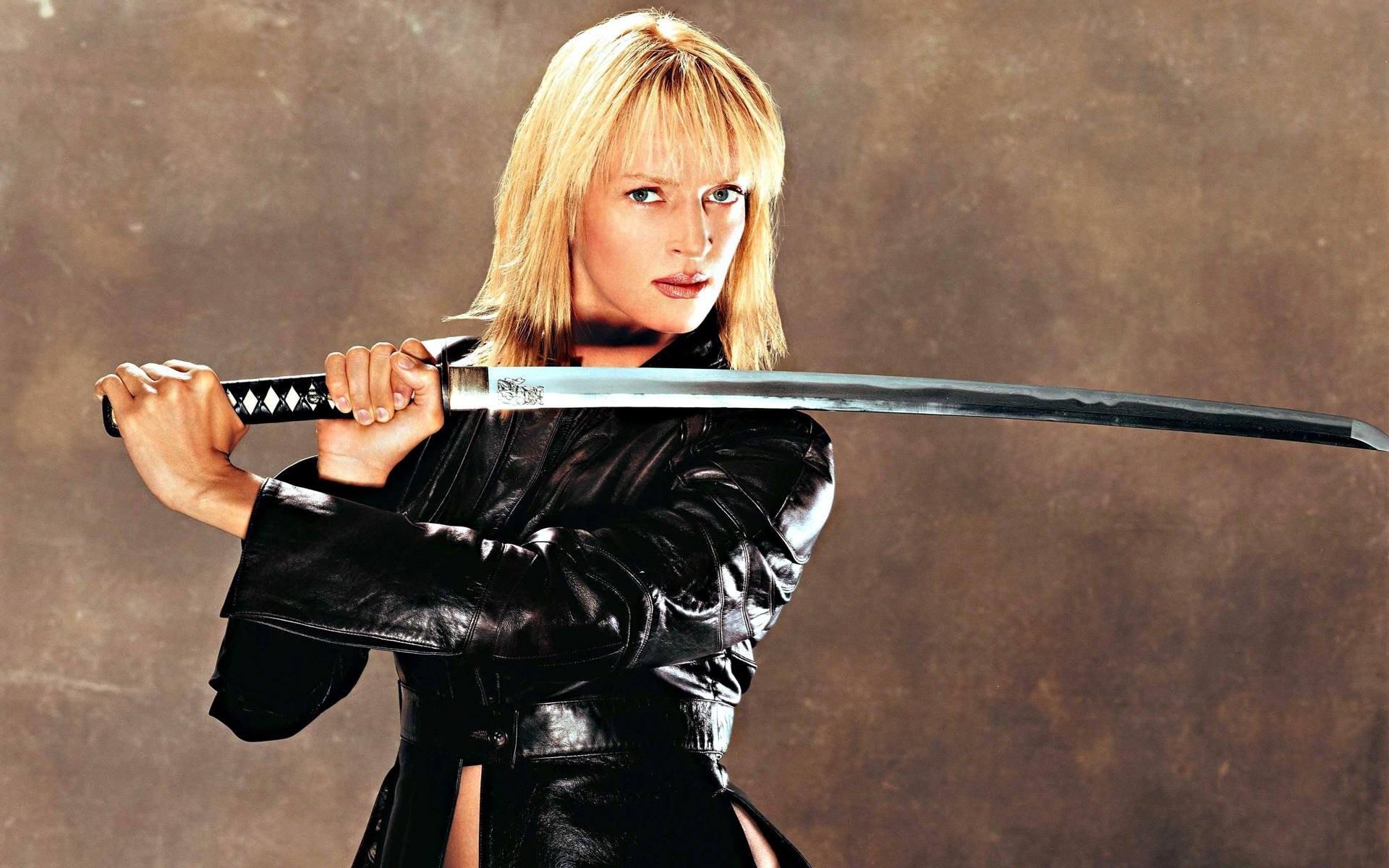 People 1920x1200 women blonde actress Uma Thurman blue eyes katana Kill Bill leather jackets simple background women with swords sword weapon movies