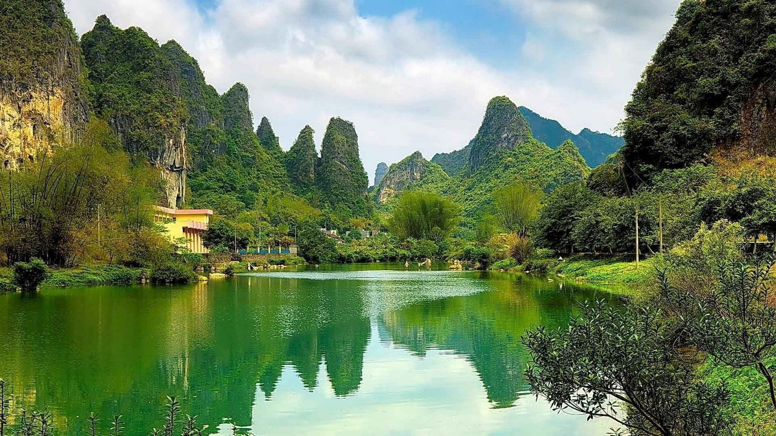 General 1600x900 mountains lake limestone China forest water reflection trees shrubs cliff nature landscape
