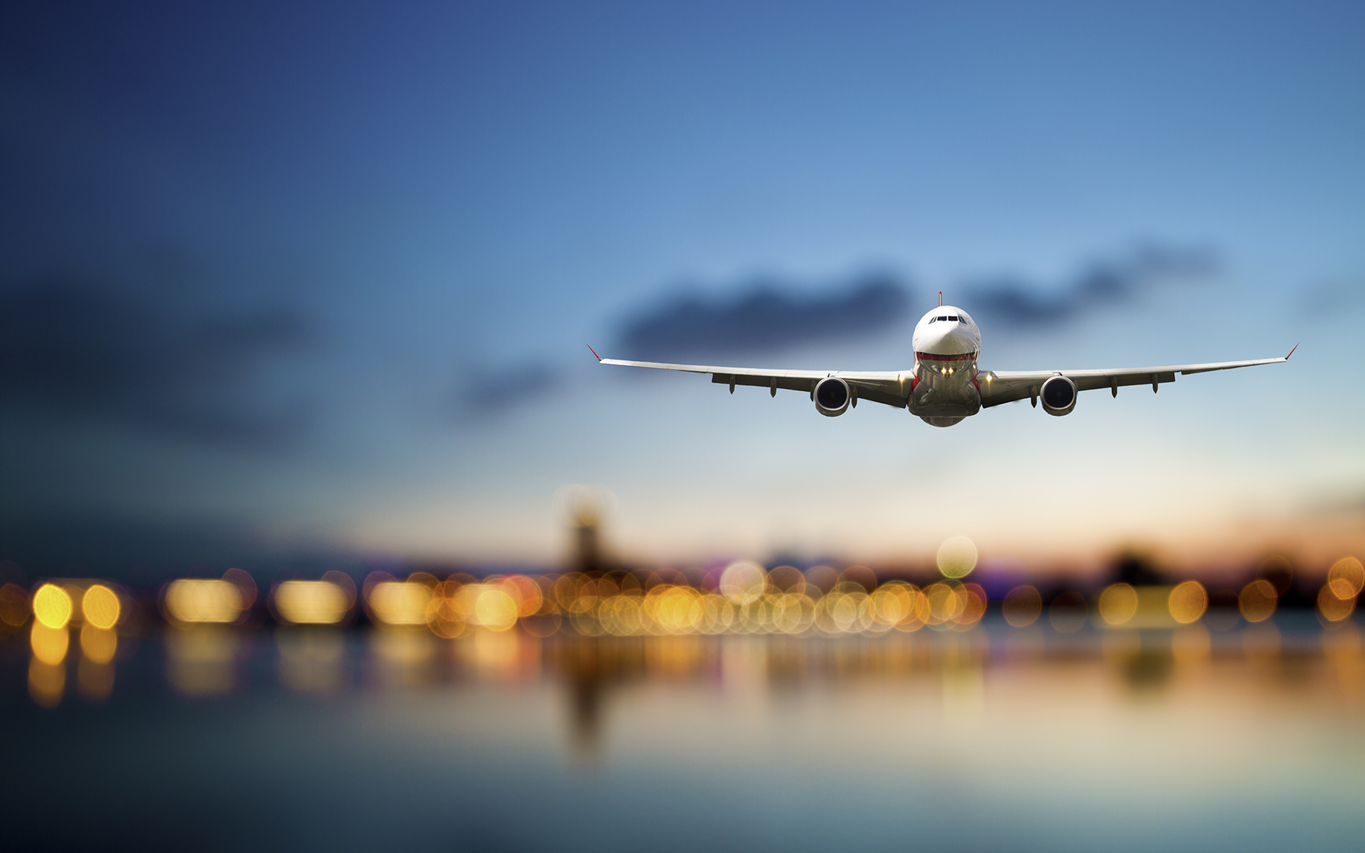 General 1920x1200 airplane passenger aircraft aircraft depth of field bokeh runway blurred sky reflection lights sunset