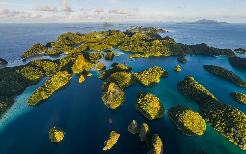 General 1500x938 landscape nature island tropical sea sunset beach limestone rock hills shrubs Indonesia green blue water