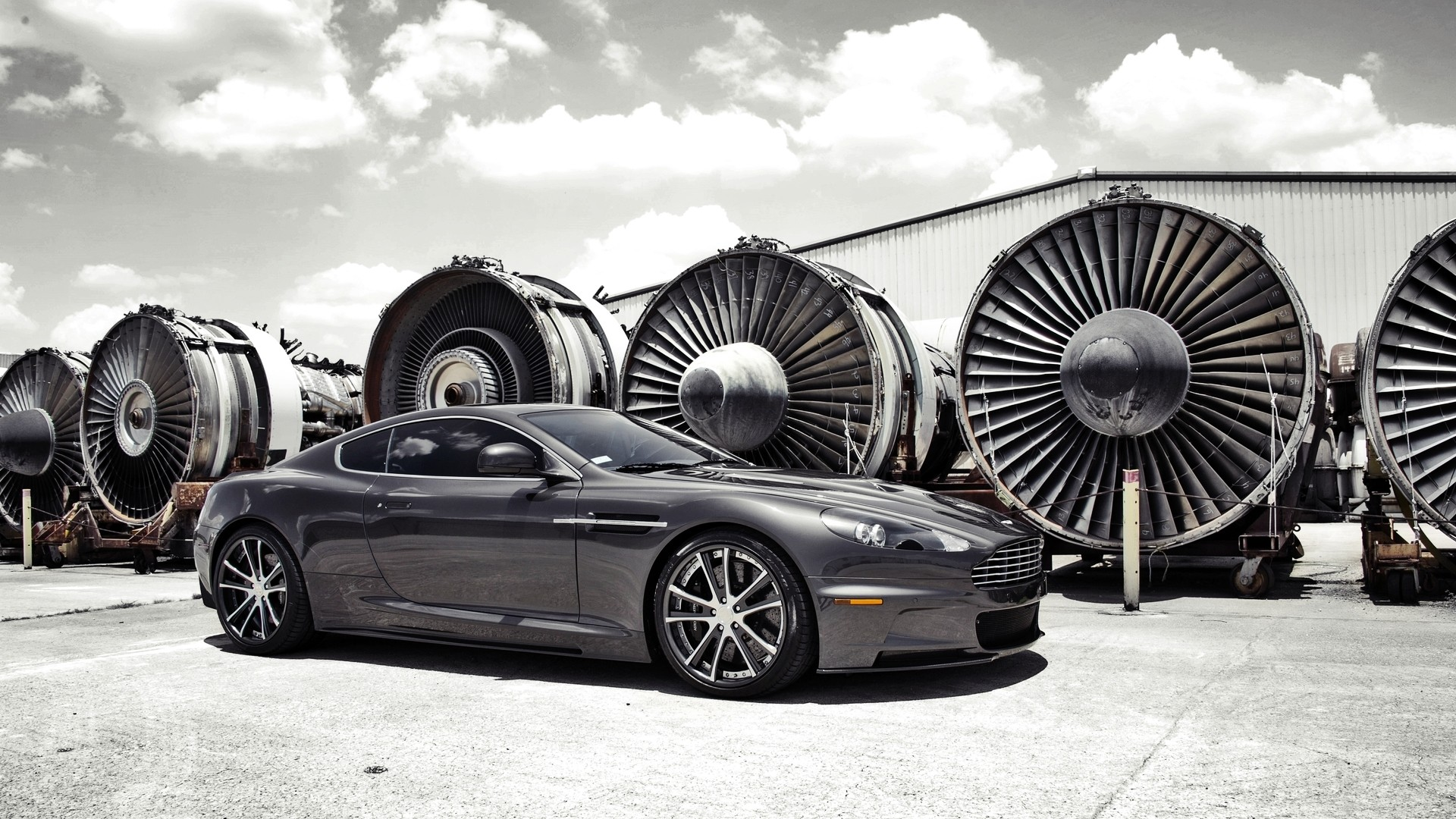 General 1920x1080 car Aston Martin vehicle turbines Aston Martin DBS hangar clouds sunlight