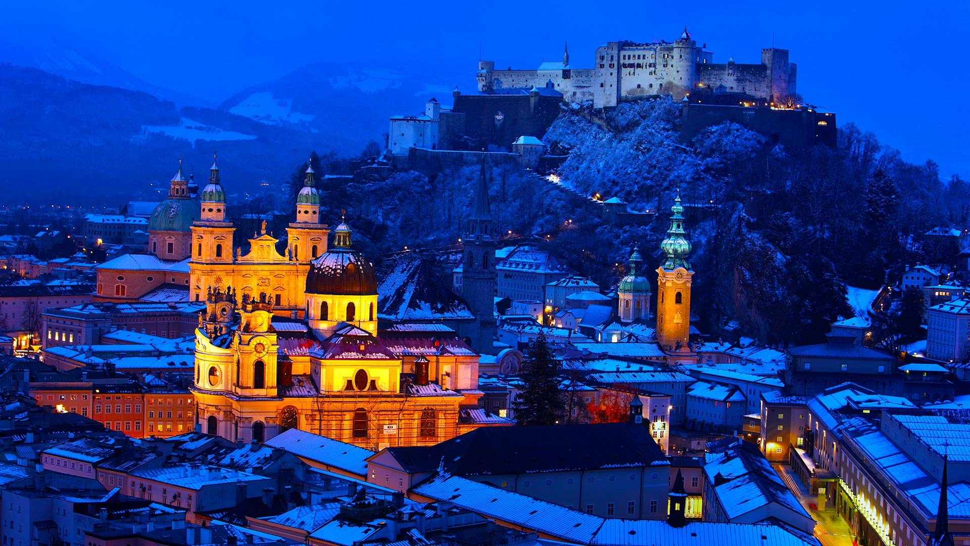 General 1920x1080 architecture building old building town house Salzburg Austria winter snow evening lights church cathedral castle hills rock rooftops ancient mountains trees forest blue
