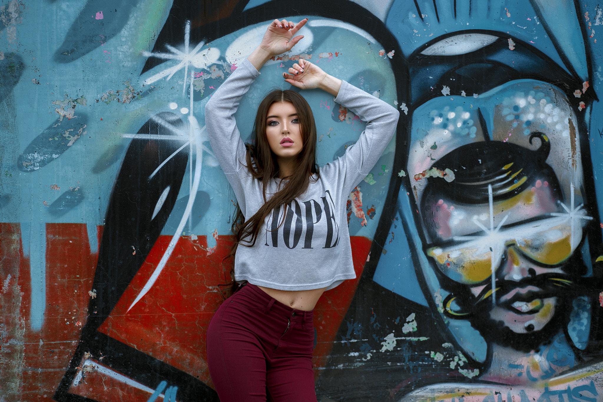 People 2048x1366 women graffiti belly arms up wall pants portrait