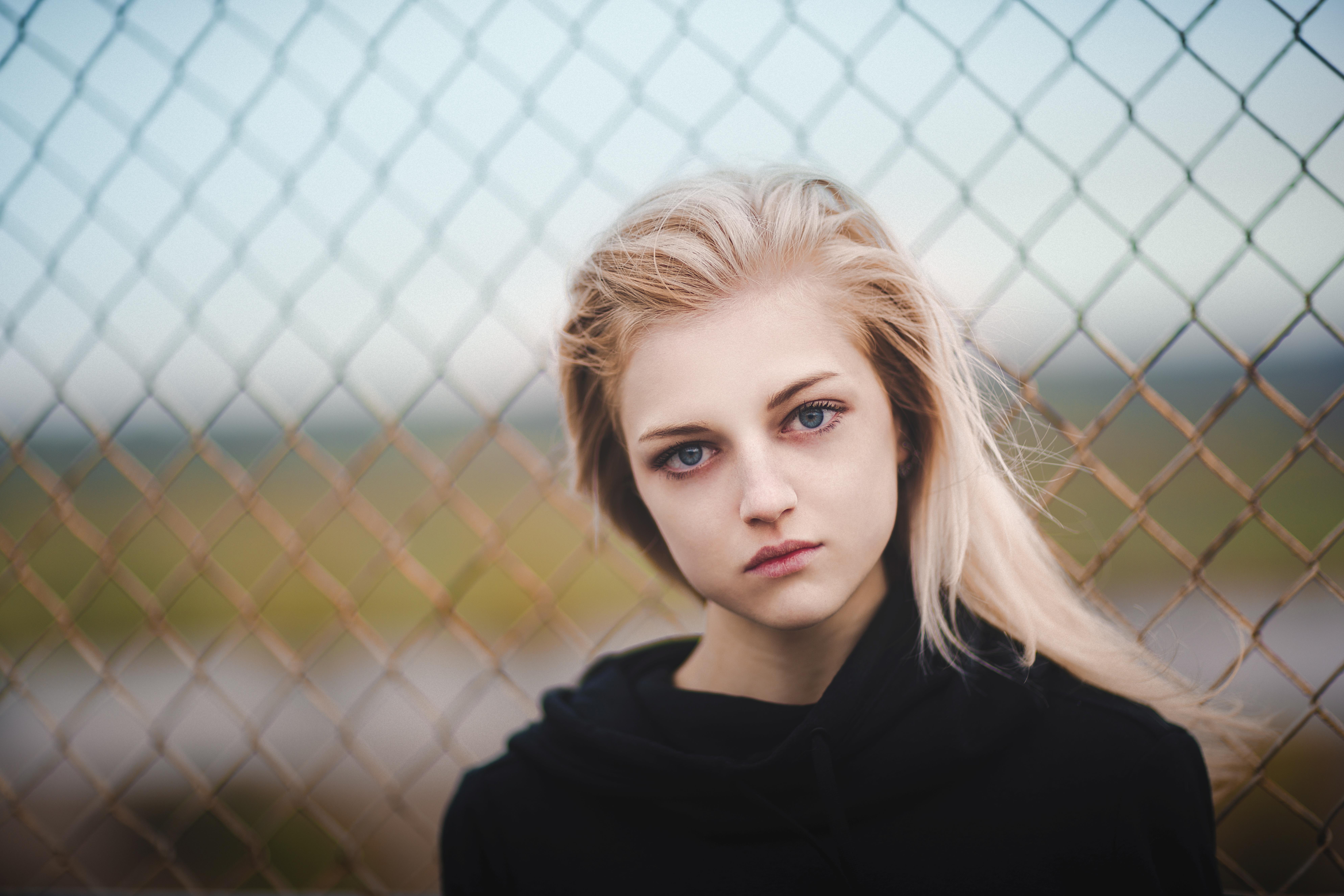 People 7952x5304 women model portrait blonde blue eyes looking at viewer black shirt fence Ilya Arte