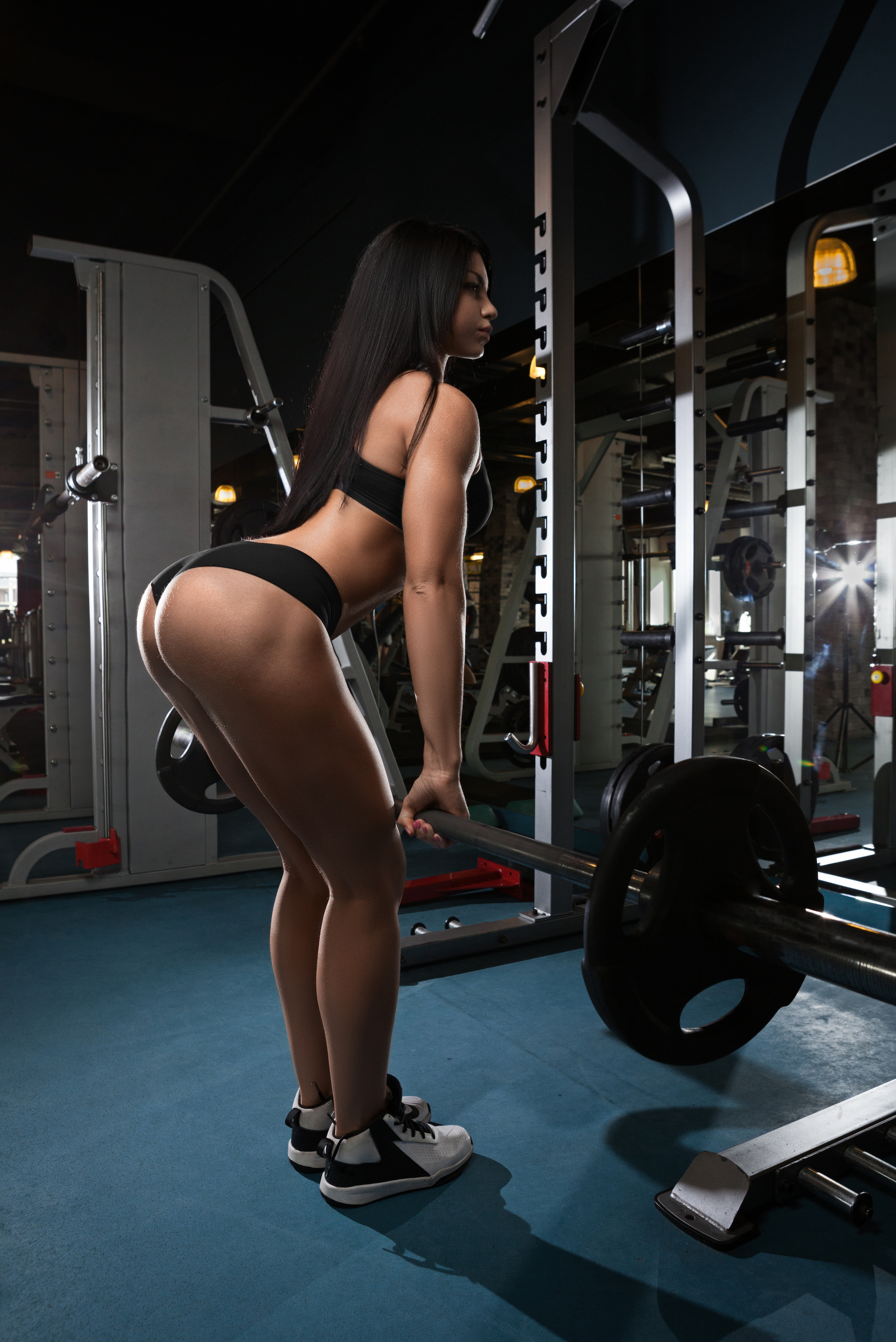 People 2004x3000 fitness model women women indoors glutes dark hair exercise barbell sports bra thong sneakers gyms side view