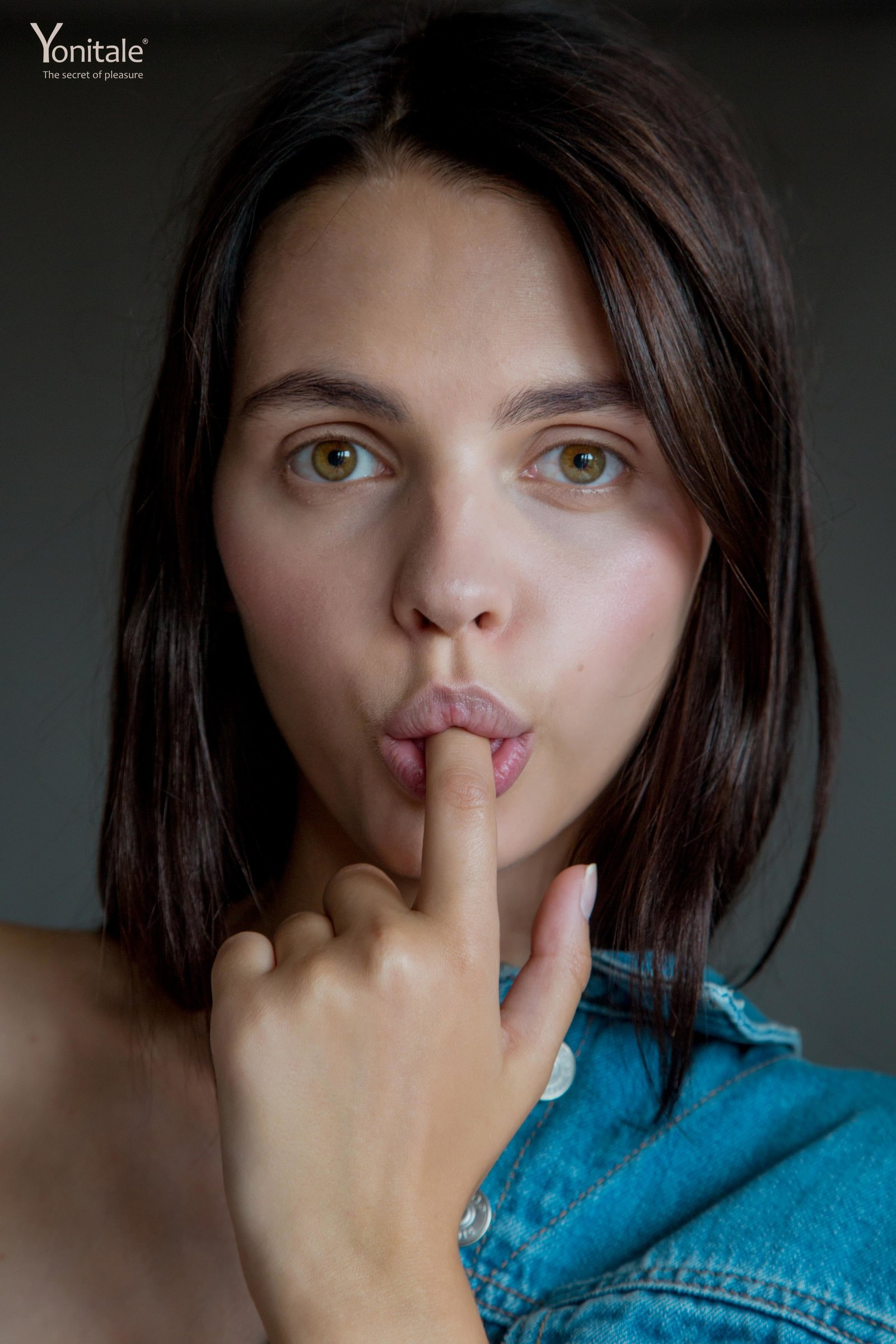 People 1600x2400 women model Lilit A Yonitale face closeup finger in mouth looking at viewer brunette portrait portrait display vertical women indoors green eyes