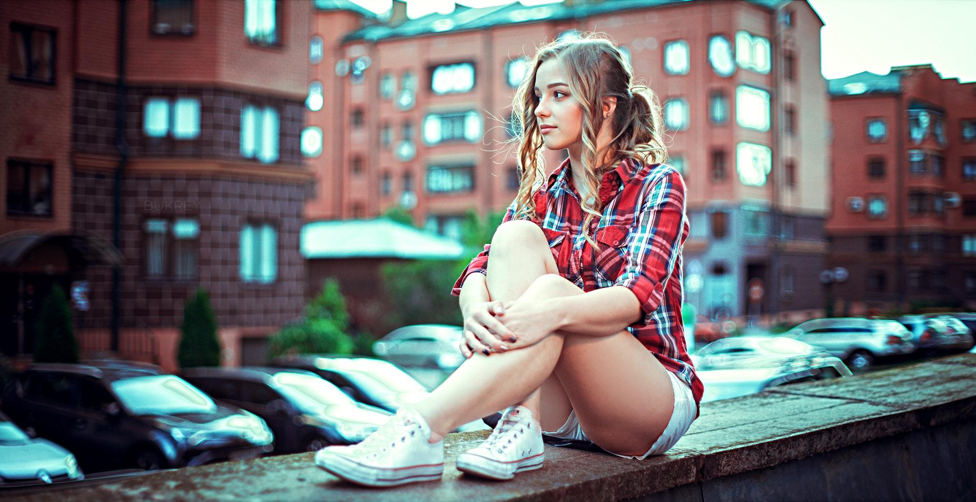 People 2000x1029 women brunette women outdoors bokeh shirt short shorts sitting urban legs looking away sneakers Kirill Bukrey plaid shirt Varya