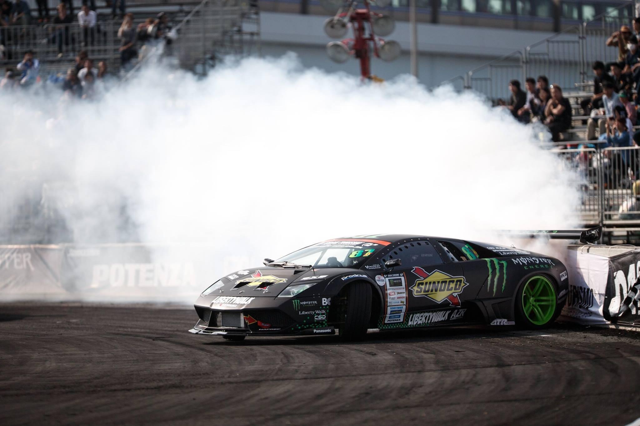 General 2048x1365 Lamborghini Lamborghini Murcielago drift Drifting Monster Energy smoke sports car race cars supercars car black cars black paint audience