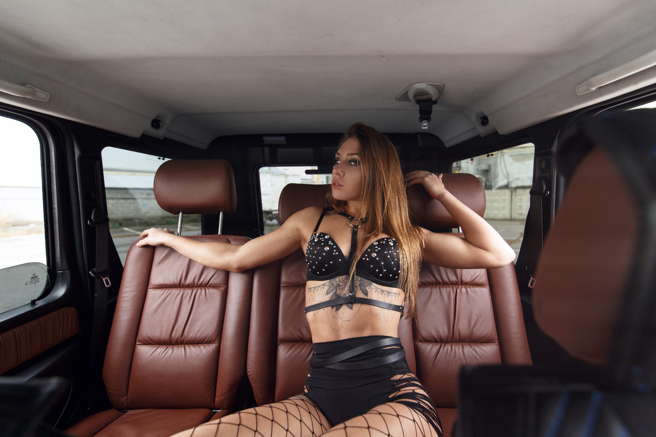 People 2560x1707 women model brunette inside a car car interior sitting lingerie black lingerie bra hiphuggers ripped clothing fishnet pantyhose looking away Sergey Sorokin