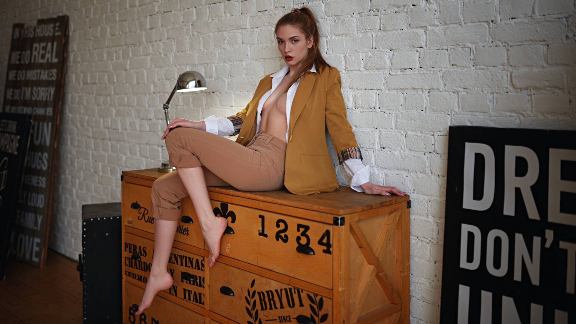 People 1920x1080 women Sergey Fat wall sitting bricks red lipstick ponytail open shirt boobs no bra pants lamp Fia Meos women indoors brunette barefoot yellow jacket white shirt unbuttoned shirt hands on knees unbuttoned tied hair hand on leg white wall sitting on the table makeup looking at viewer