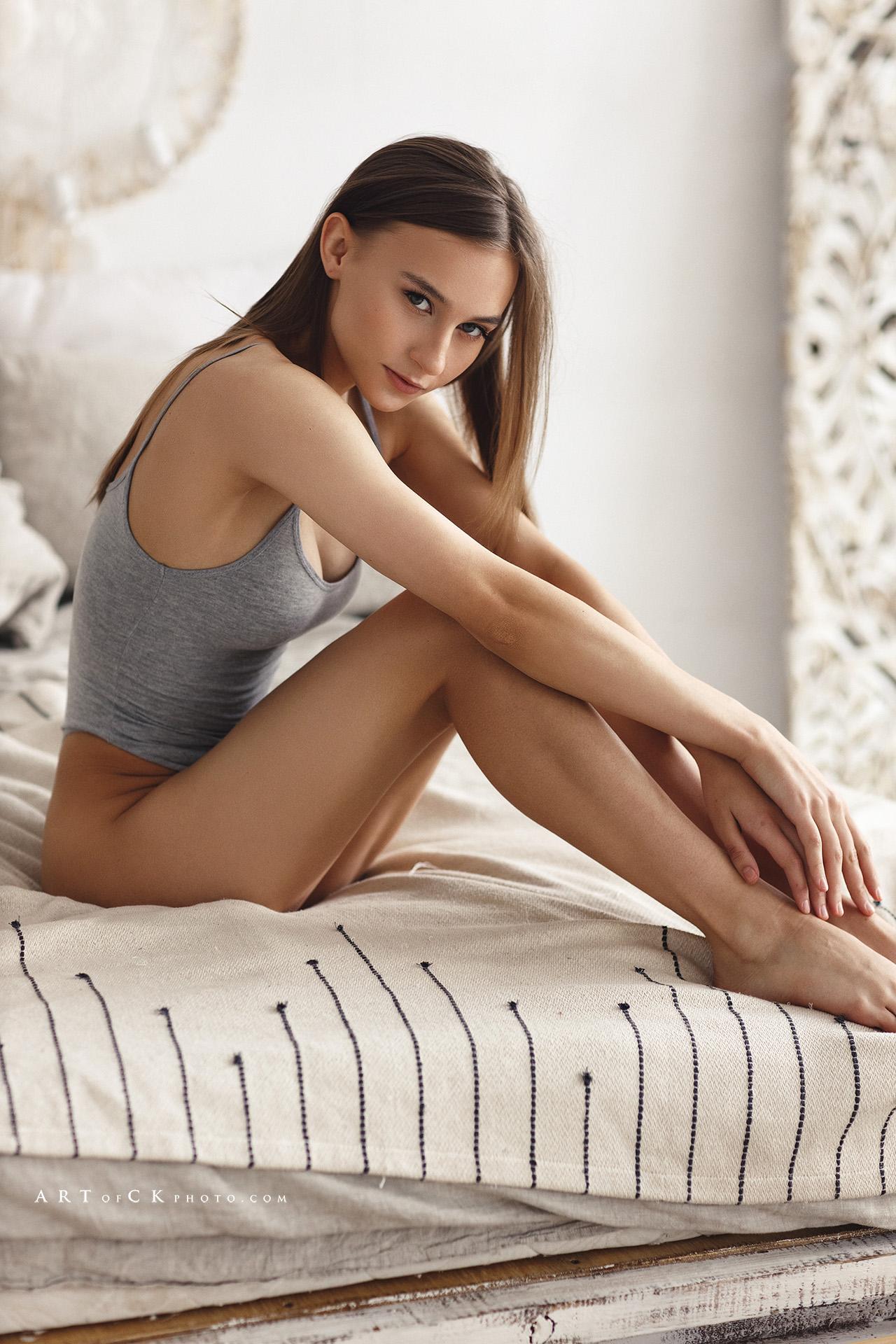 People 1280x1920 Stepan Kvardakov women brunette long hair straight hair looking at viewer bodysuit legs grey clothing in bed bed lingerie bottomless grey tops Ekaterina Ovchukhova