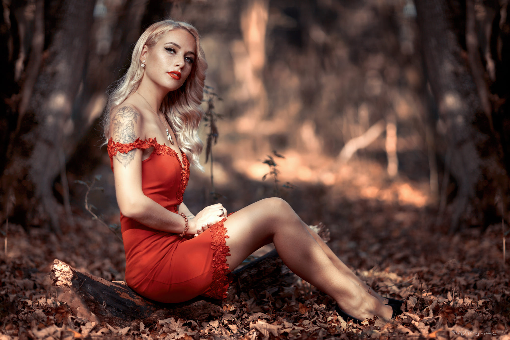 People 2000x1333 women blonde face women outdoors forest sitting dress legs bare shoulders portrait red dress red lipstick freckles tattoo Vincent Haetty