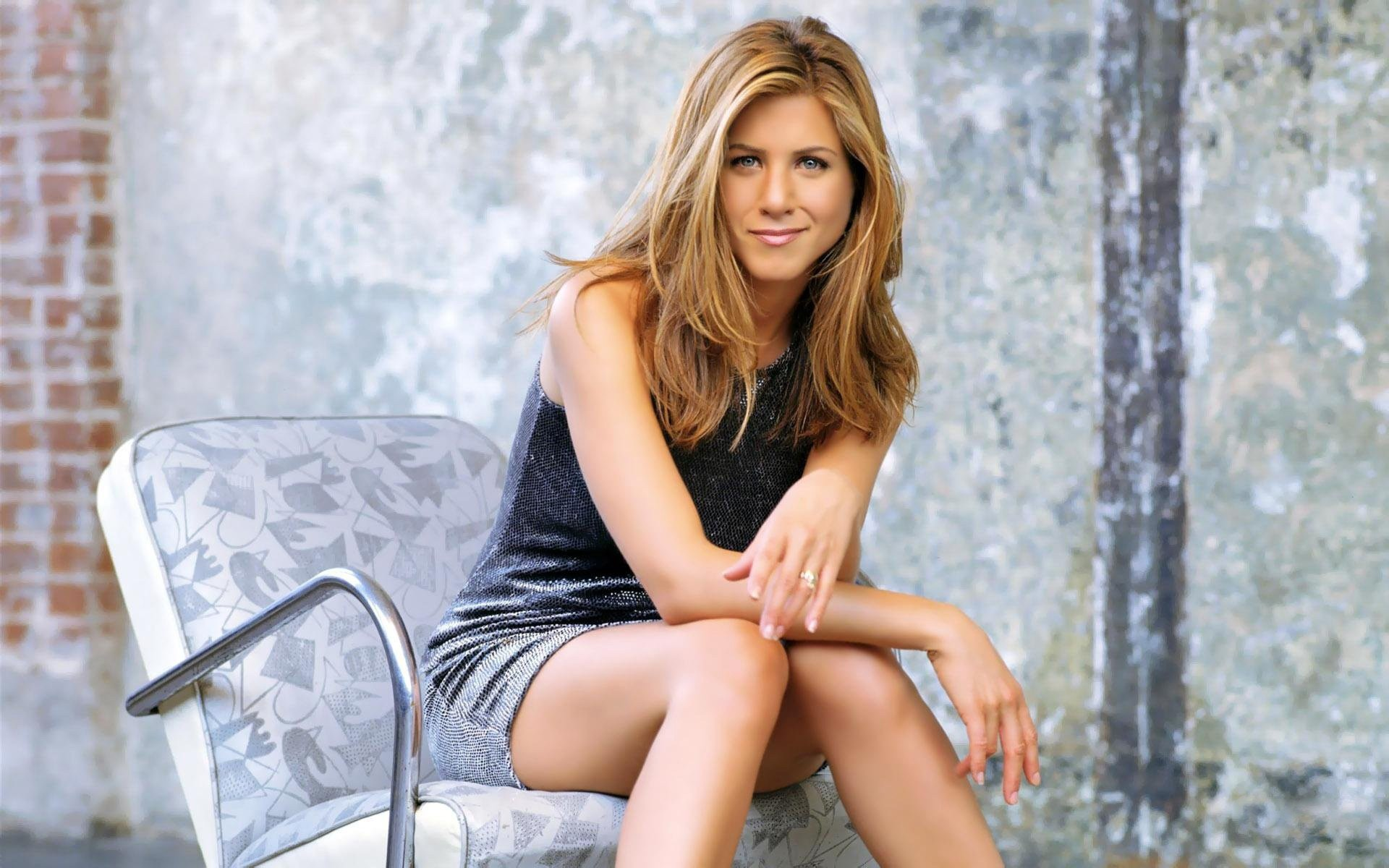 People 1920x1200 women Jennifer Aniston actress brunette smiling sitting grey dress legs together looking at viewer