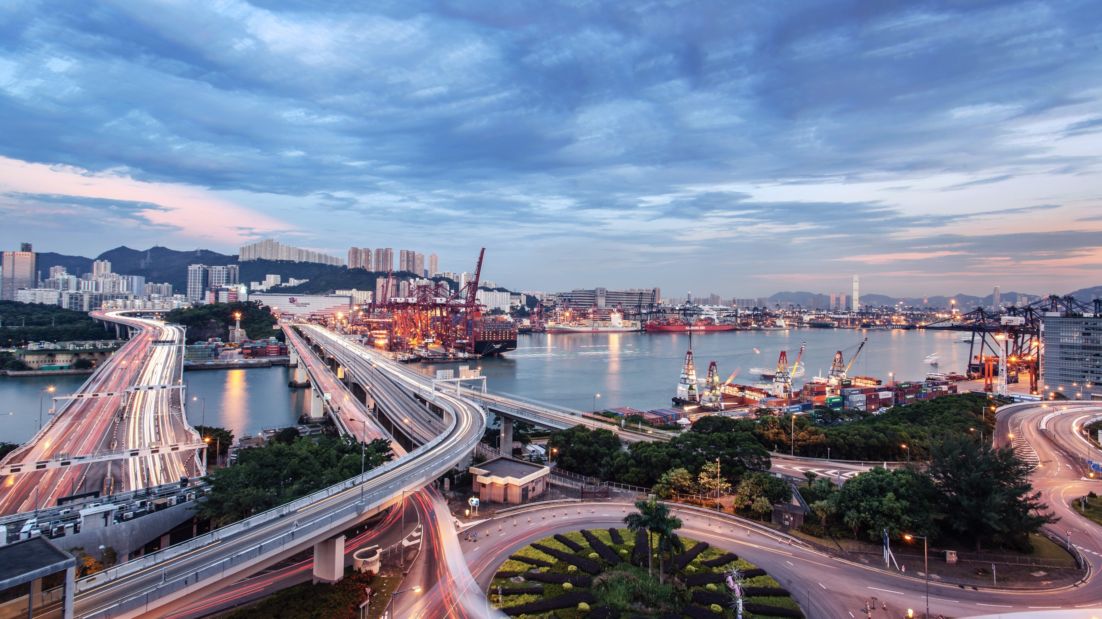 General 3840x2160 architecture building city cityscape clouds river road ship dock lights light trails evening sunset roundabouts trees container ship container cranes (machine) long exposure street Hong Kong