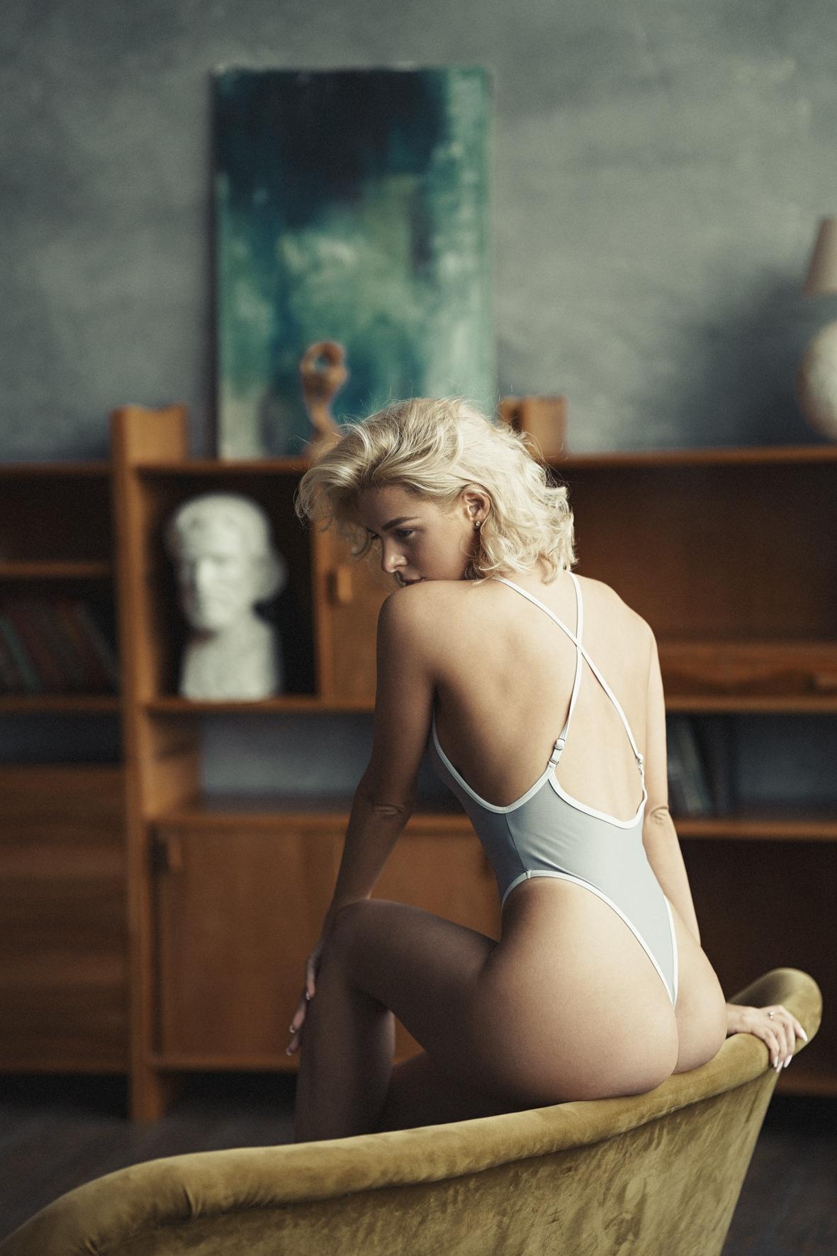 People 1181x1772 Vladimir Serkov women Alexandra Romanovna blonde short hair wavy hair bodysuit ass couch indoors