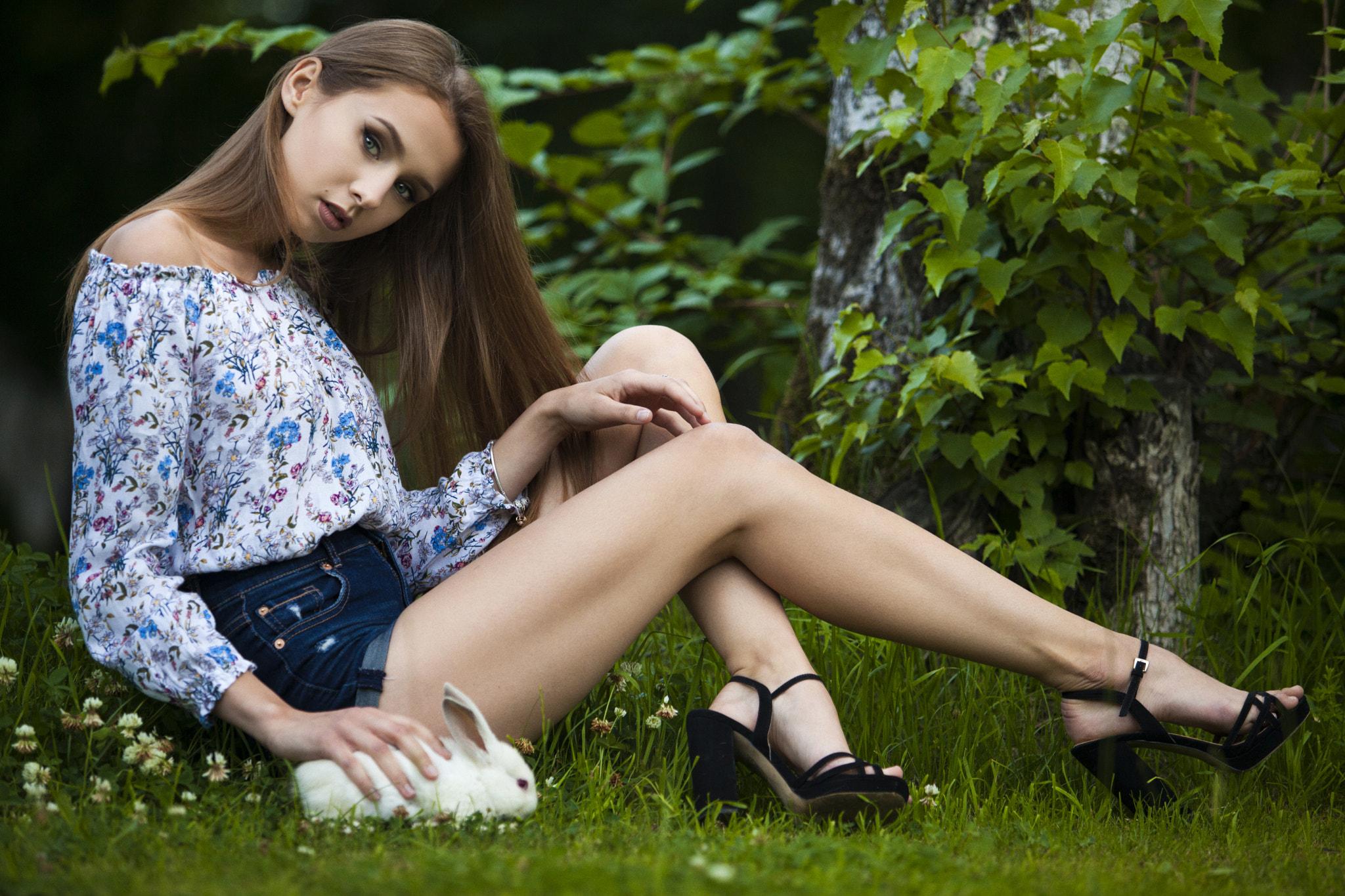 People 2048x1365 women sitting jean shorts rabbits high heels brunette grass portrait women outdoors