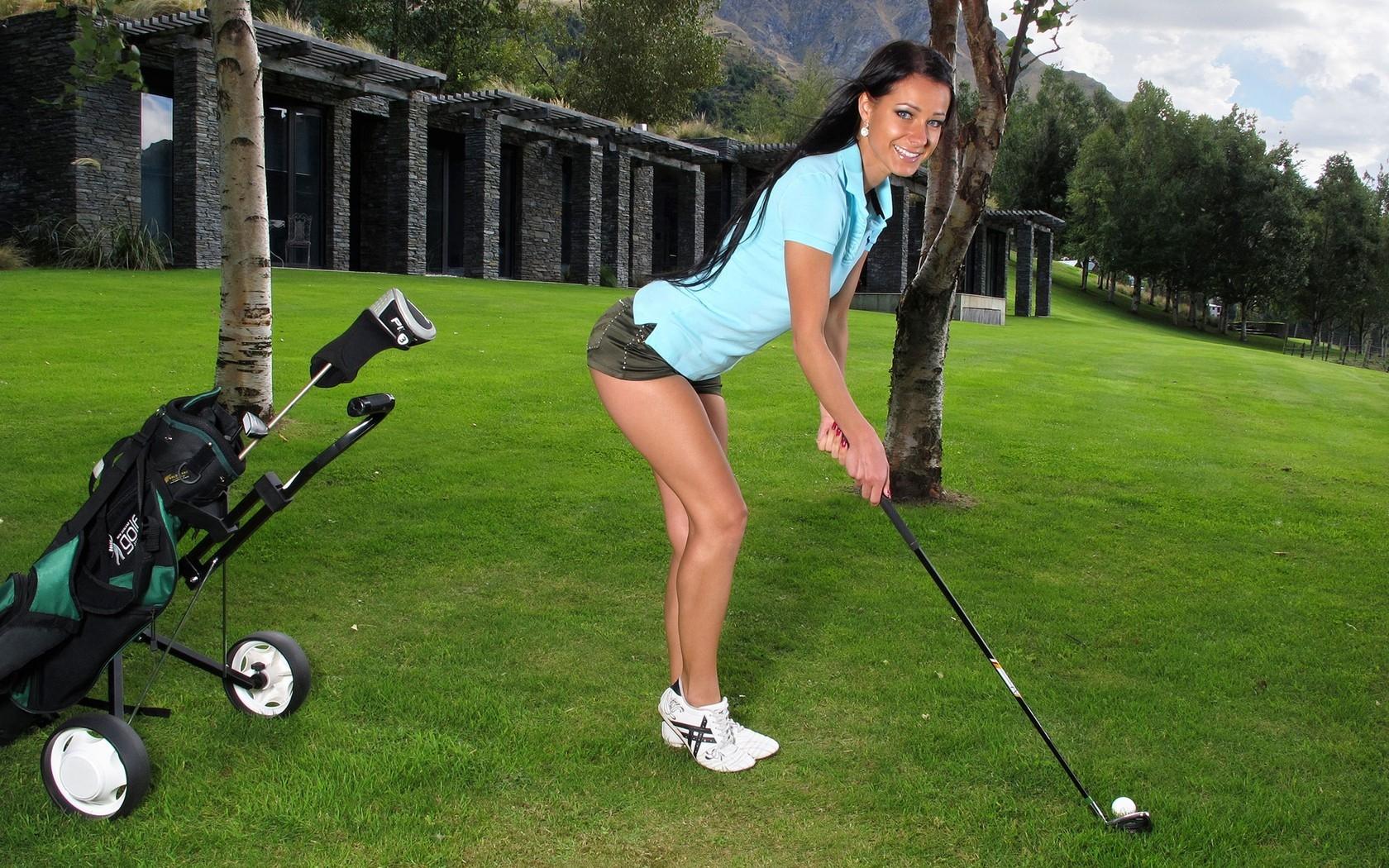 People 1680x1050 Kristina Uhrinova model women brunette golf Golf Ball golf club golf course sneakers outdoors long hair blue shirt InTheCrack 2012 (Year)