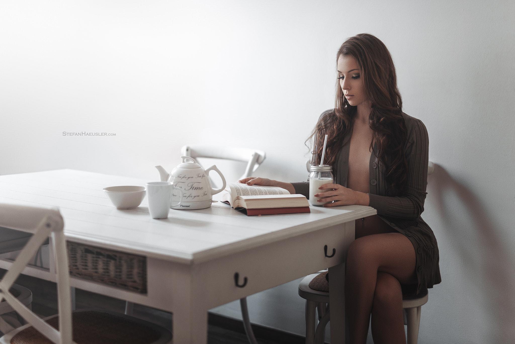 People 2048x1366 Viktoria Stephanie Stefan Häusler women sitting milk legs crossed women indoors books cup chair table brunette open sweater Viktoria Kummer