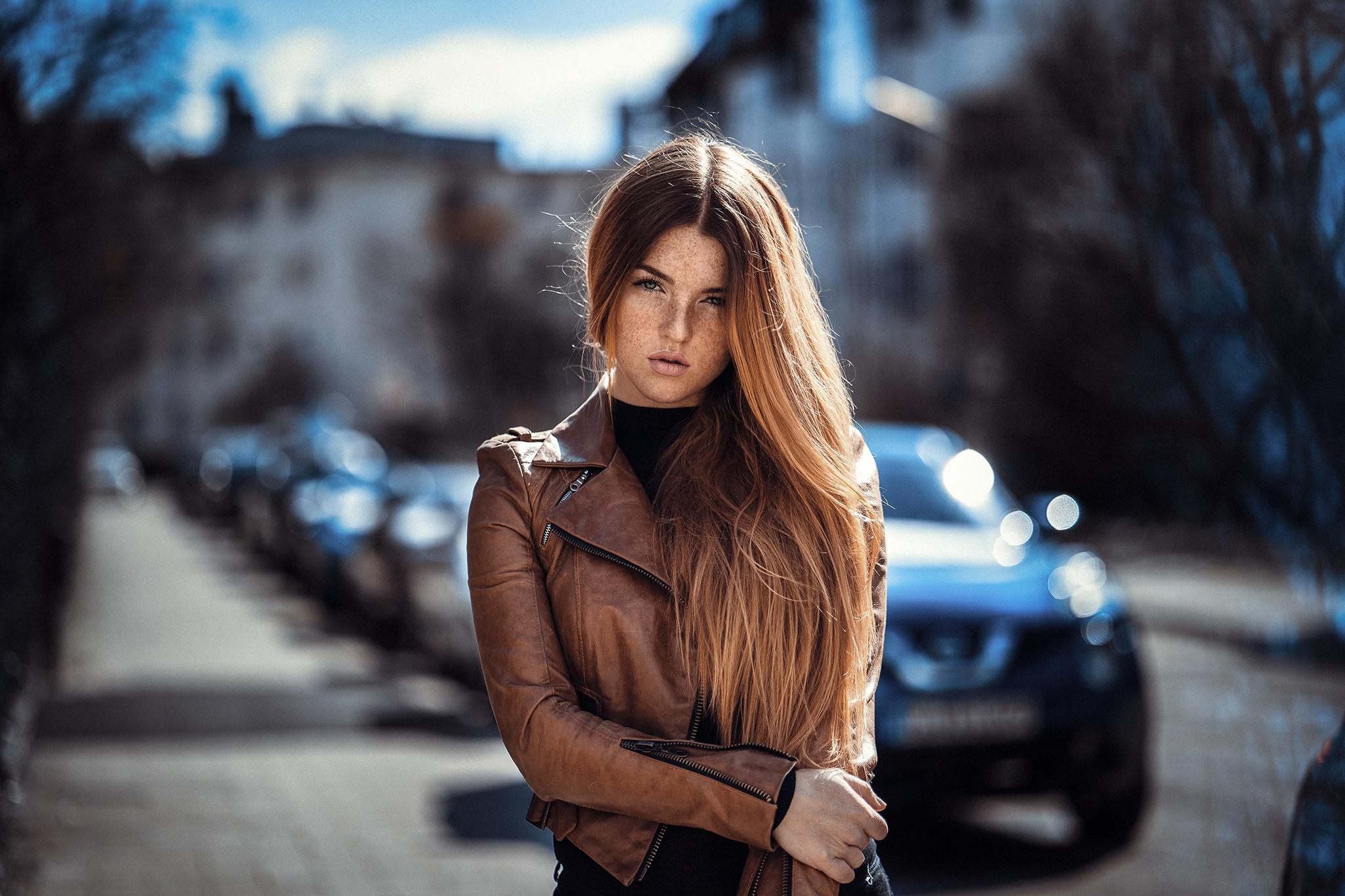 People 2048x1365 Anatoli Oskin women long hair urban model women outdoors brown jacket jacket leather jackets freckles frontal view Lara Vogel