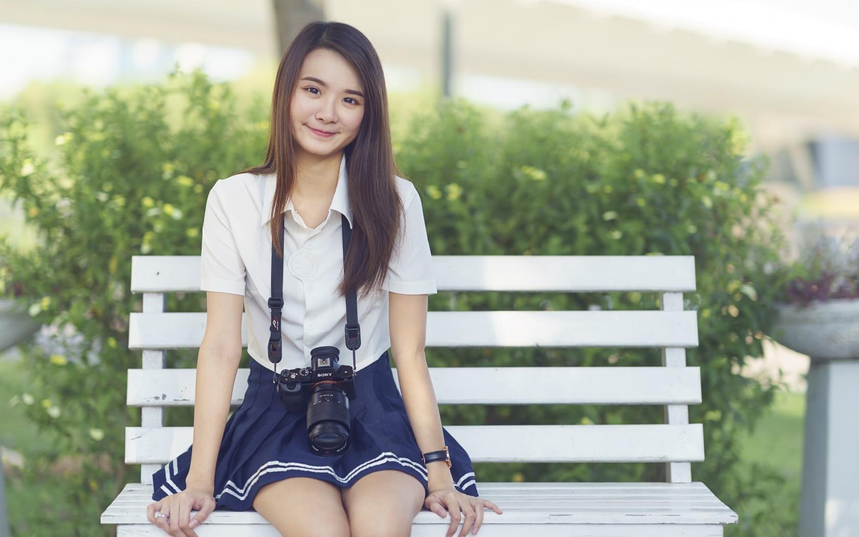 People 1680x1050 bench camera smiling Asian women outdoors schoolgirl skirt Jowyn Chow