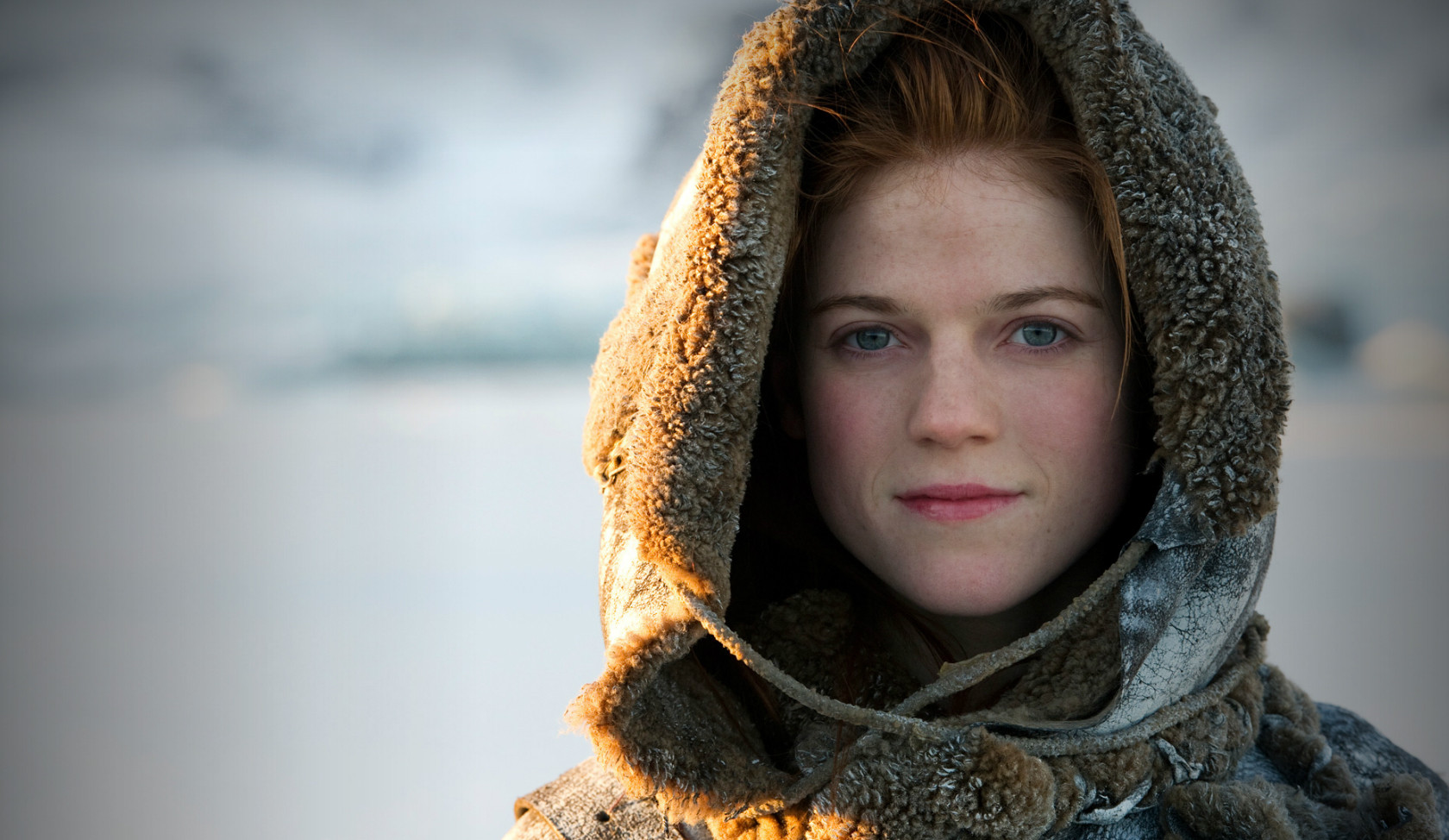 People 1680x974 Rose Leslie Ygritte redhead snow women actress blue eyes Game of Thrones hoods scottish