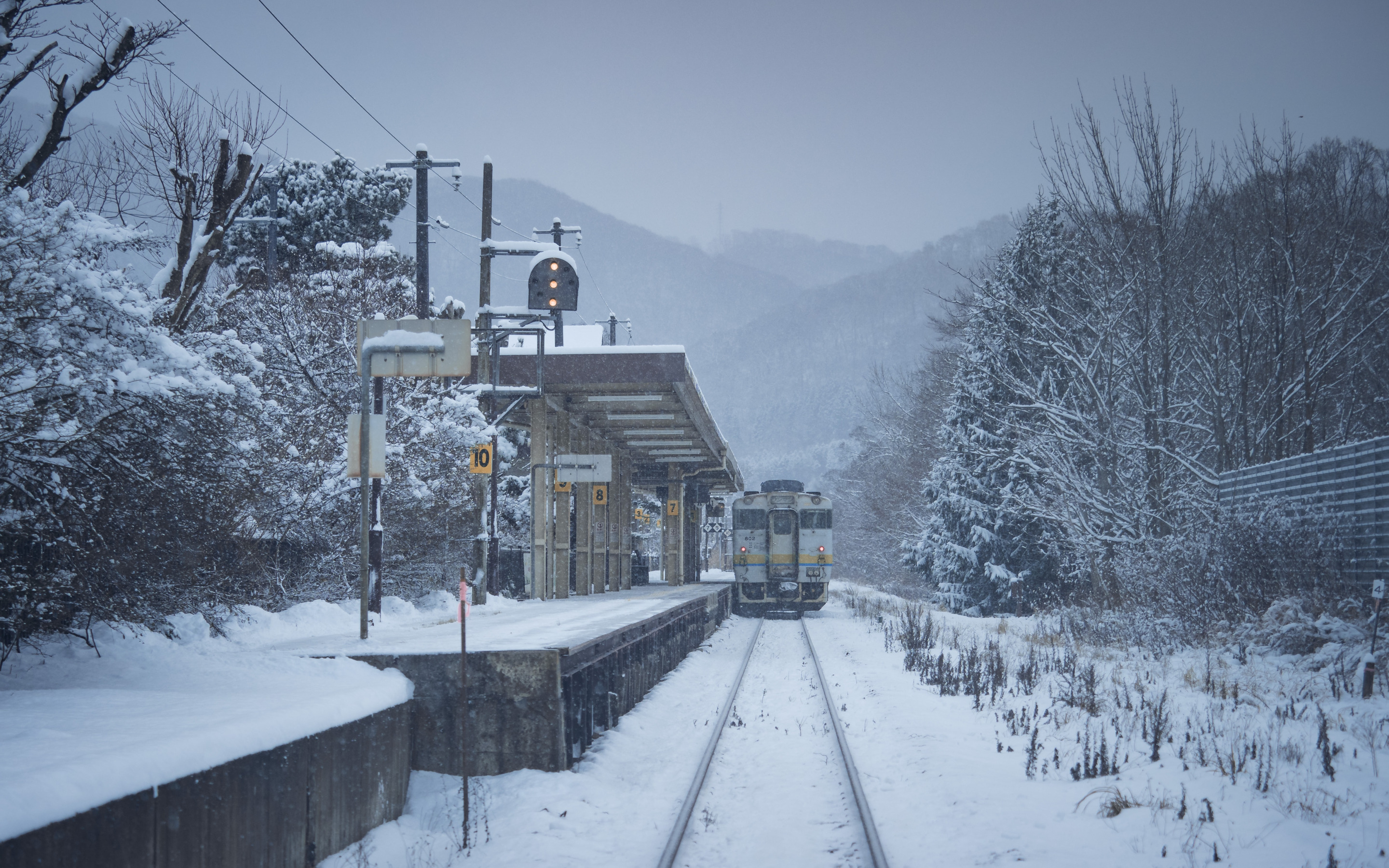 General 2880x1800 nature landscape winter snow trees forest snowing mountains railway Japan train train station