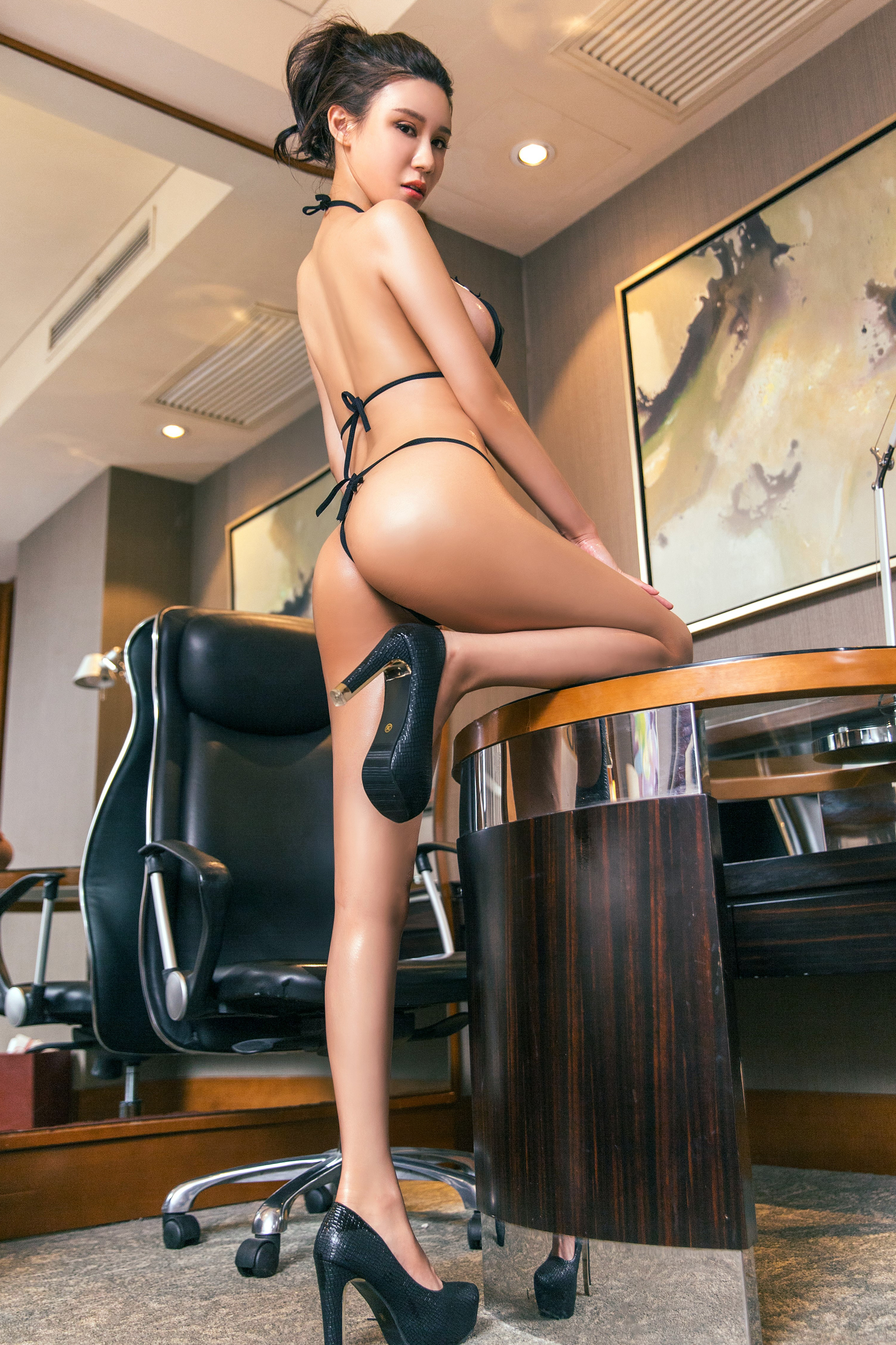 People 2000x3000 body oil gloss sideboob pumps high heels G-strings black bikini office office girl hairbun back ass bent legs standing arched back Asian looking back looking at viewer legs rear view nipple through clothing women Chinese China