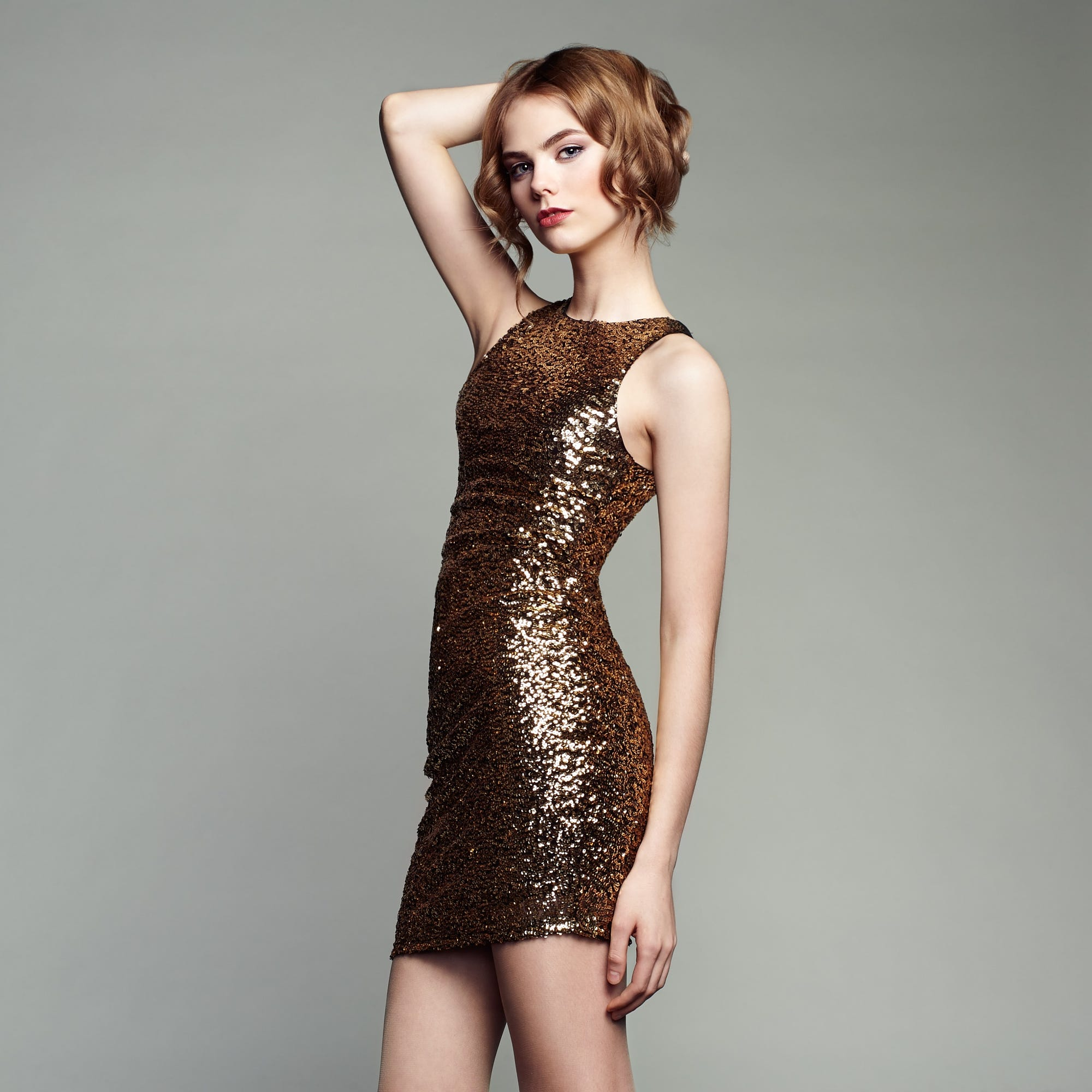 People 2000x2000 Oleg Gekman women brunette short hair hands in hair wavy hair makeup fashion gold looking at viewer lipstick tight clothing simple background scales