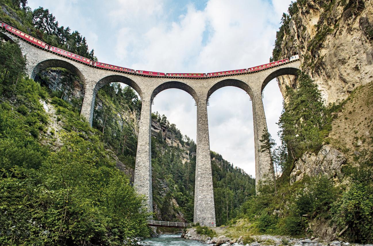 General 1298x855 nature forest bridge train Switzerland Landwasser Viaduct arch low-angle