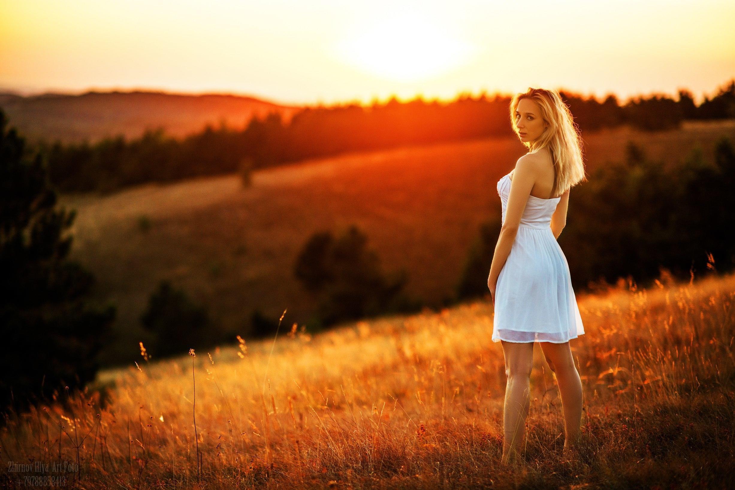 People 2453x1637 women model blonde strapless dress white dress summer  dress field looking  over shoulder legs looking at viewer women outdoors Ilya Zhirnov