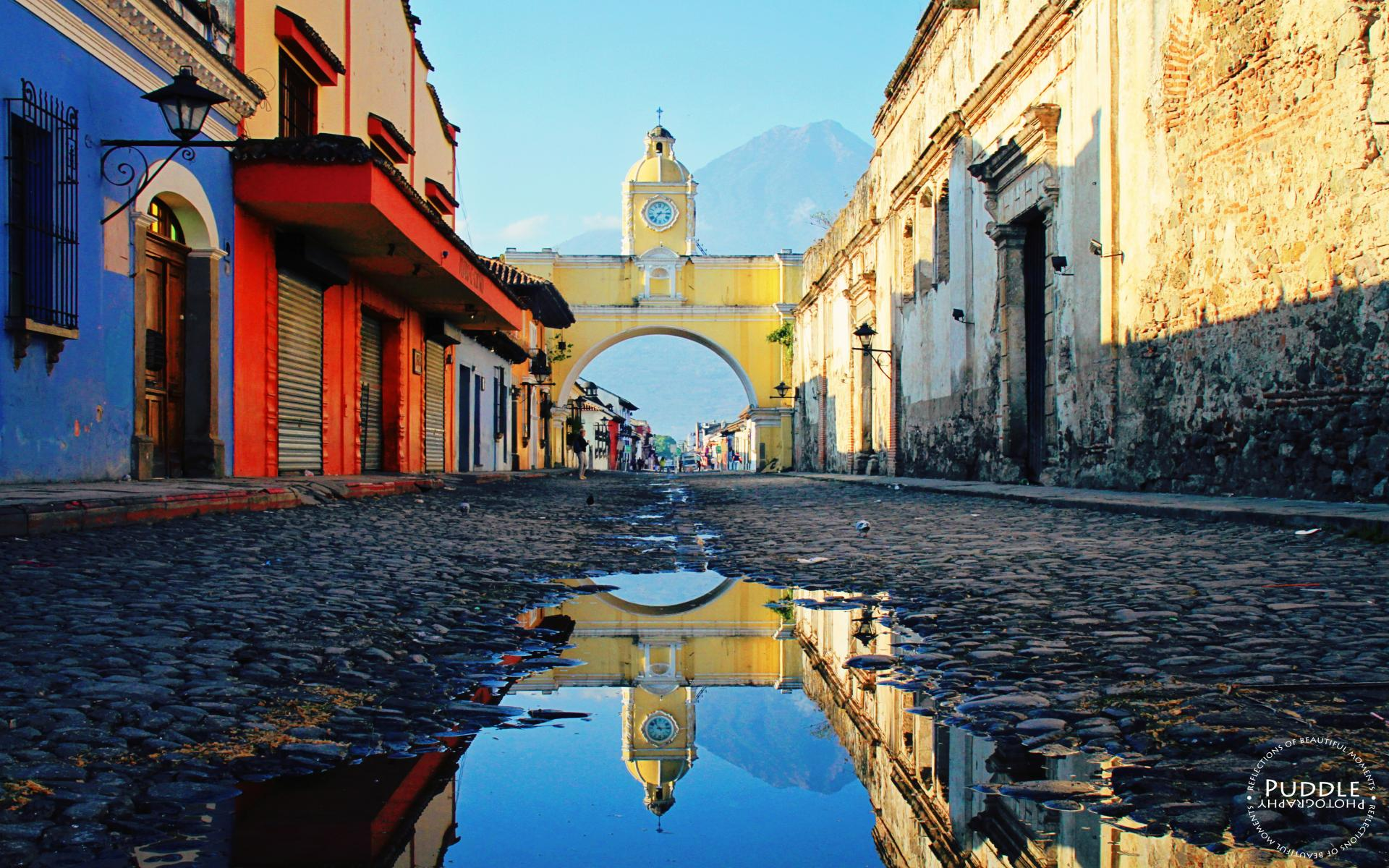 General 1920x1200 Guatemala town street water cobblestone clocktowers old building house arch mountains reflection people watermarked Arch of Santa Catalina Arco de Santa Catalina Antigua Guatemala