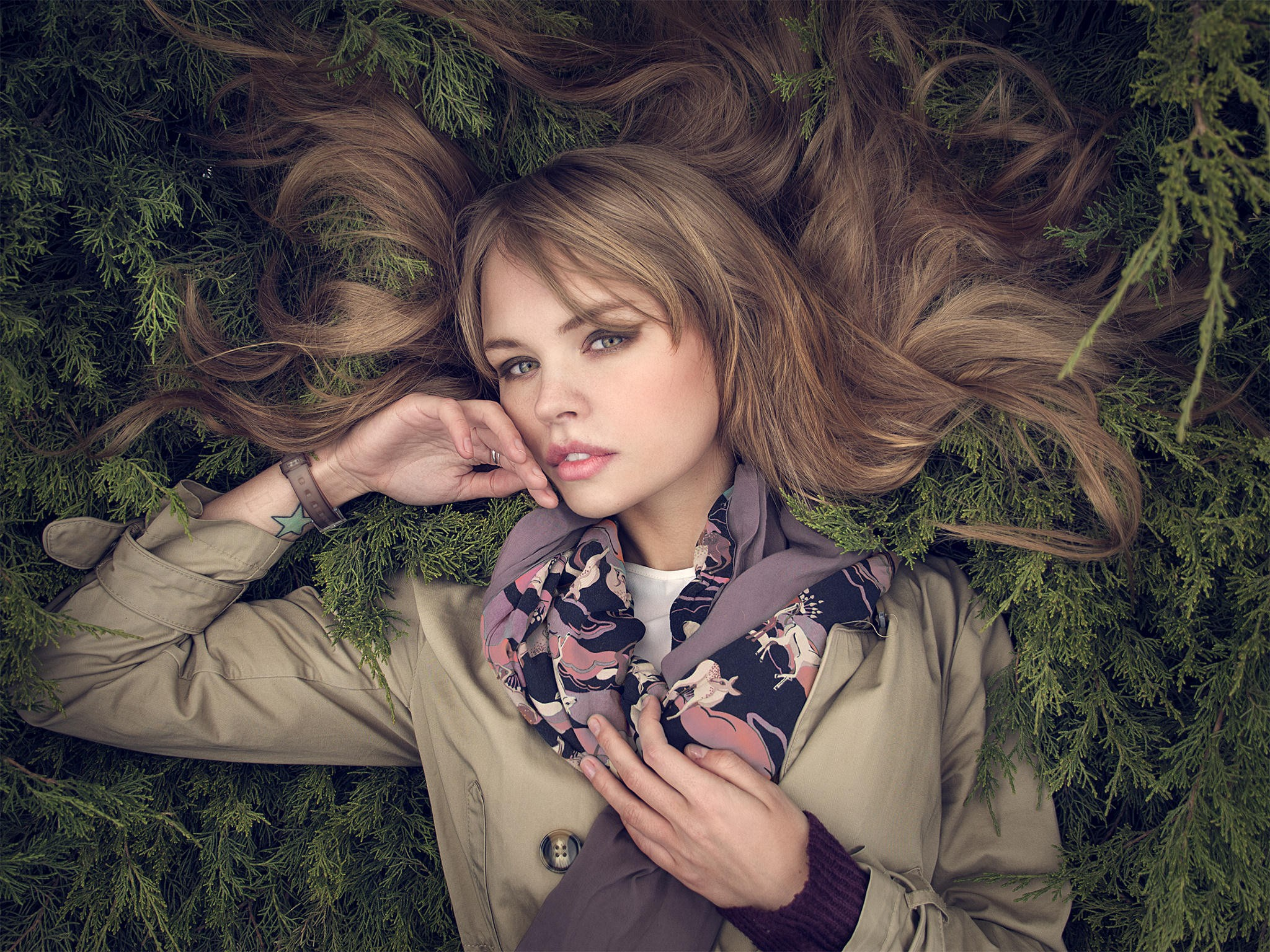 People 2048x1536 Anastasia Scheglova women model face portrait hair spread out trench coat coats touching face makeup scarf looking at viewer lying on back lying down Russian women Russian model parted lips