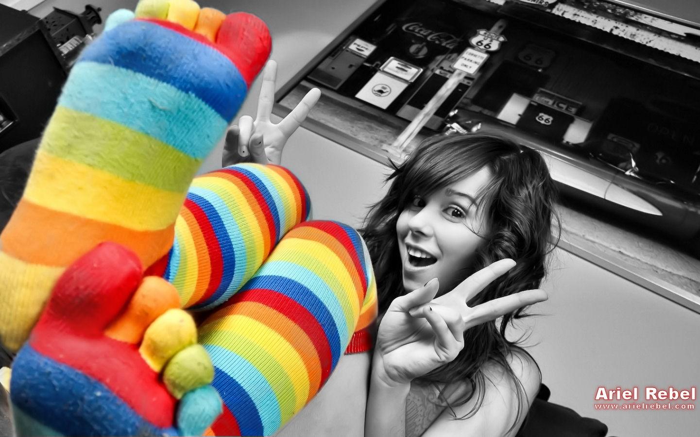 People 1441x900 Ariel Rebel women socks striped socks toe socks peace sign legs up feet in the air toes brunette bent legs rainbow clothing rainbow socks watermarked open mouth looking at viewer