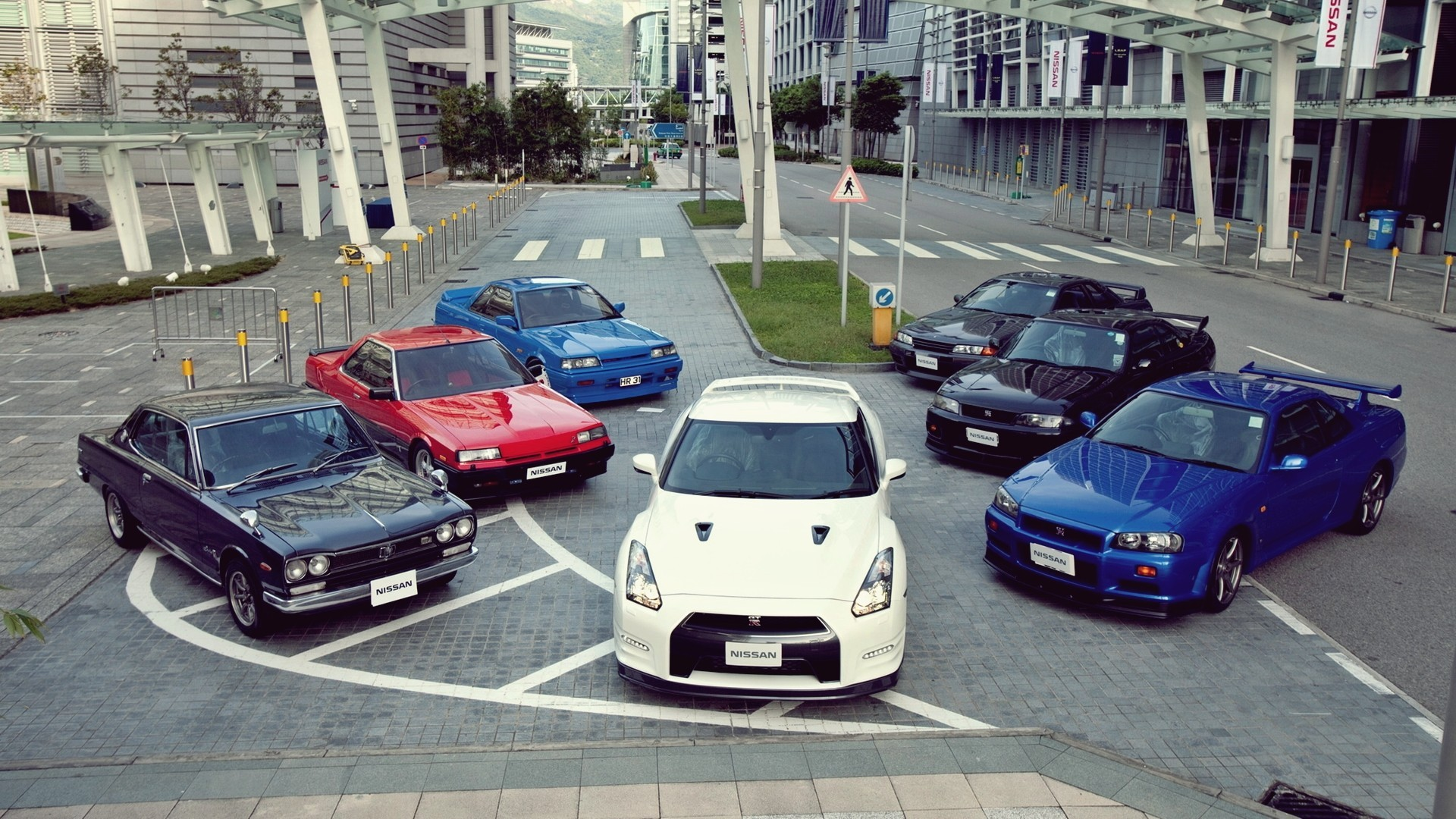 General 1920x1080 Nissan Nissan Skyline Nissan GT-R R32 Nissan Skyline GT-R R33 Nissan Skyline GT-R R34 Nissan GTR car Japanese cars vehicle white cars blue cars red cars cityscape Nissan Skyline C10